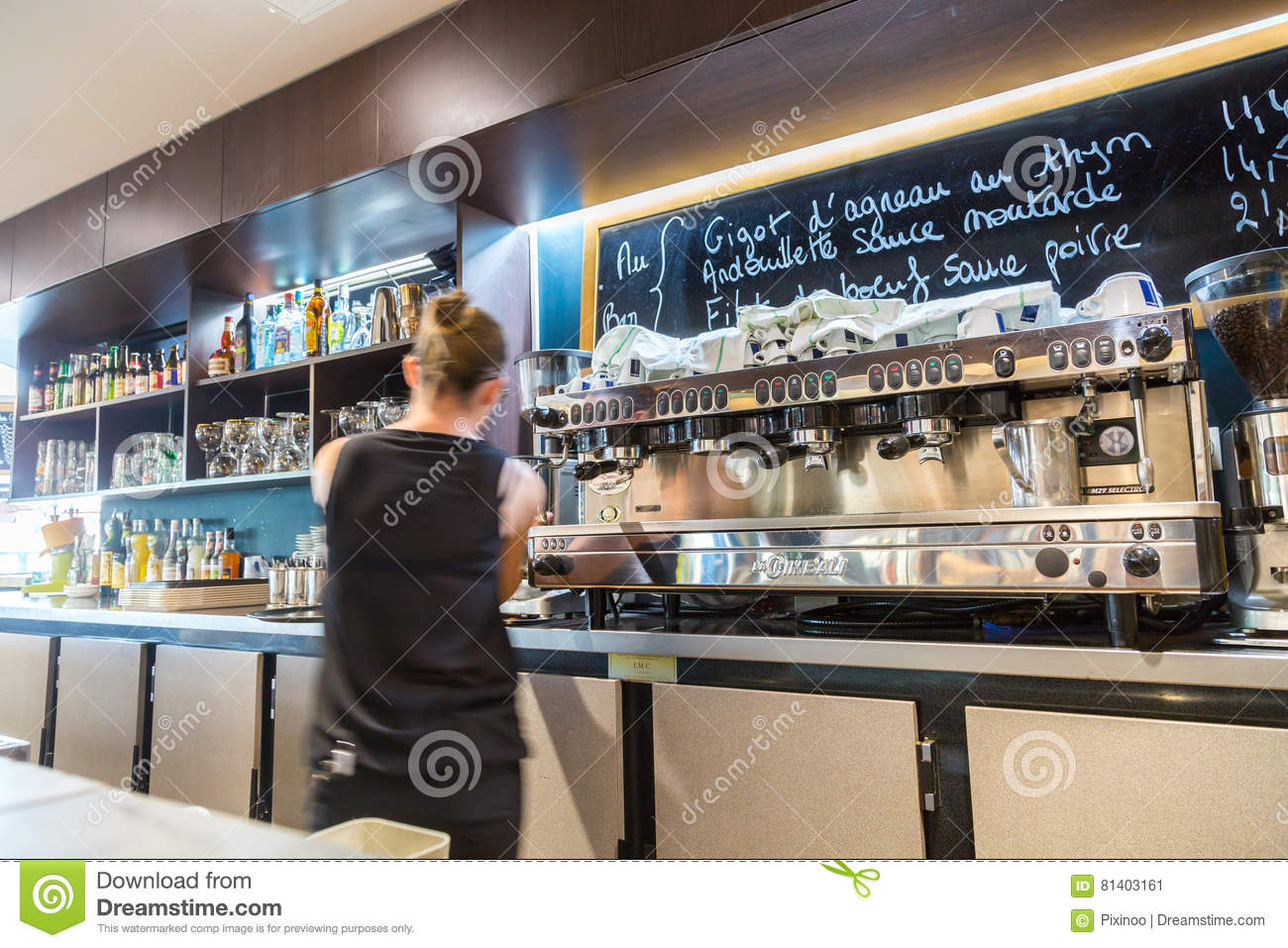 La defense, France - July 17, 2016: blurry barmaid in big traditional french restaurant in la defense city, the greatest business