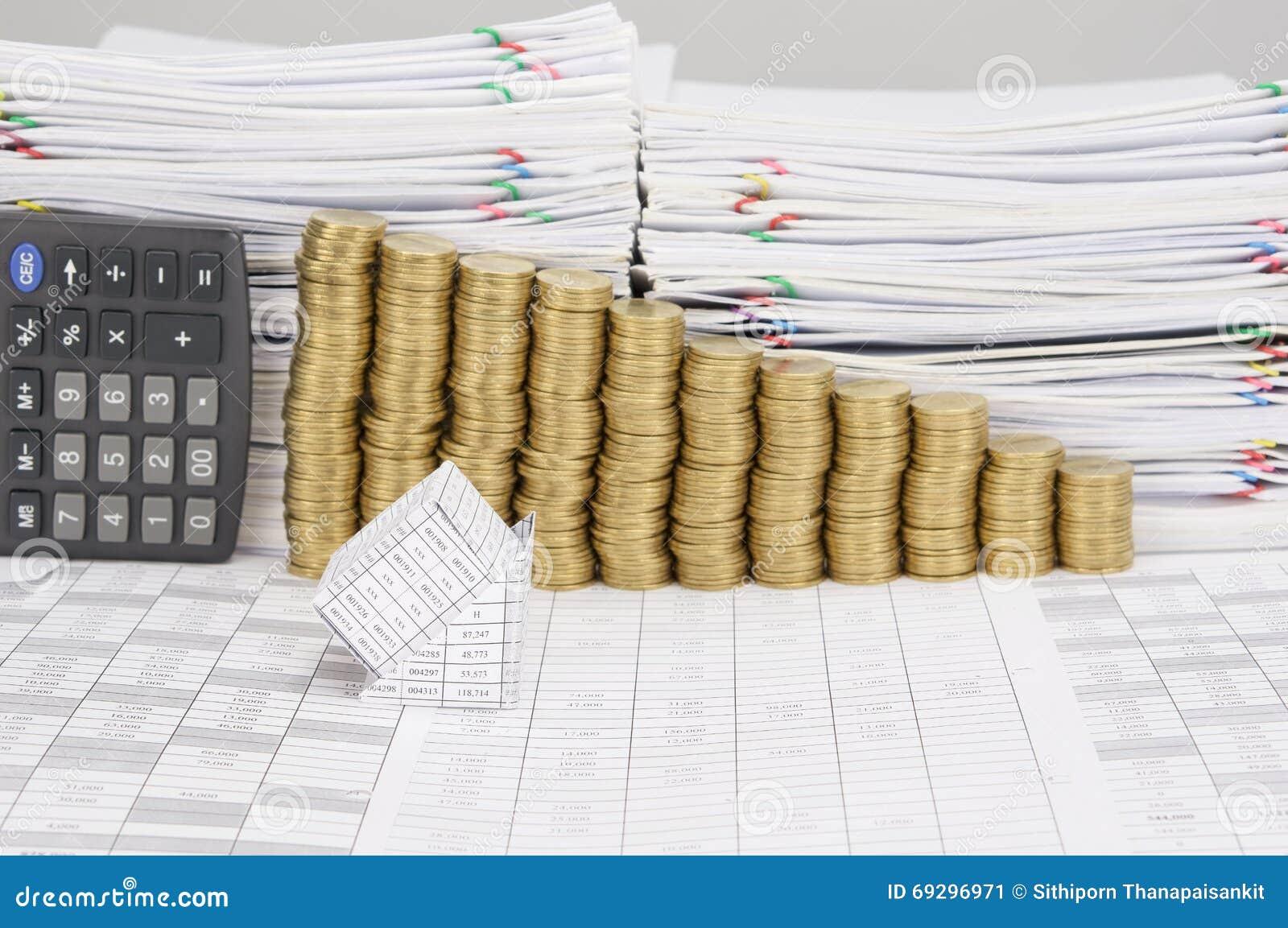 la faillite de la maison ont la pile d'étape des pièces d'or image