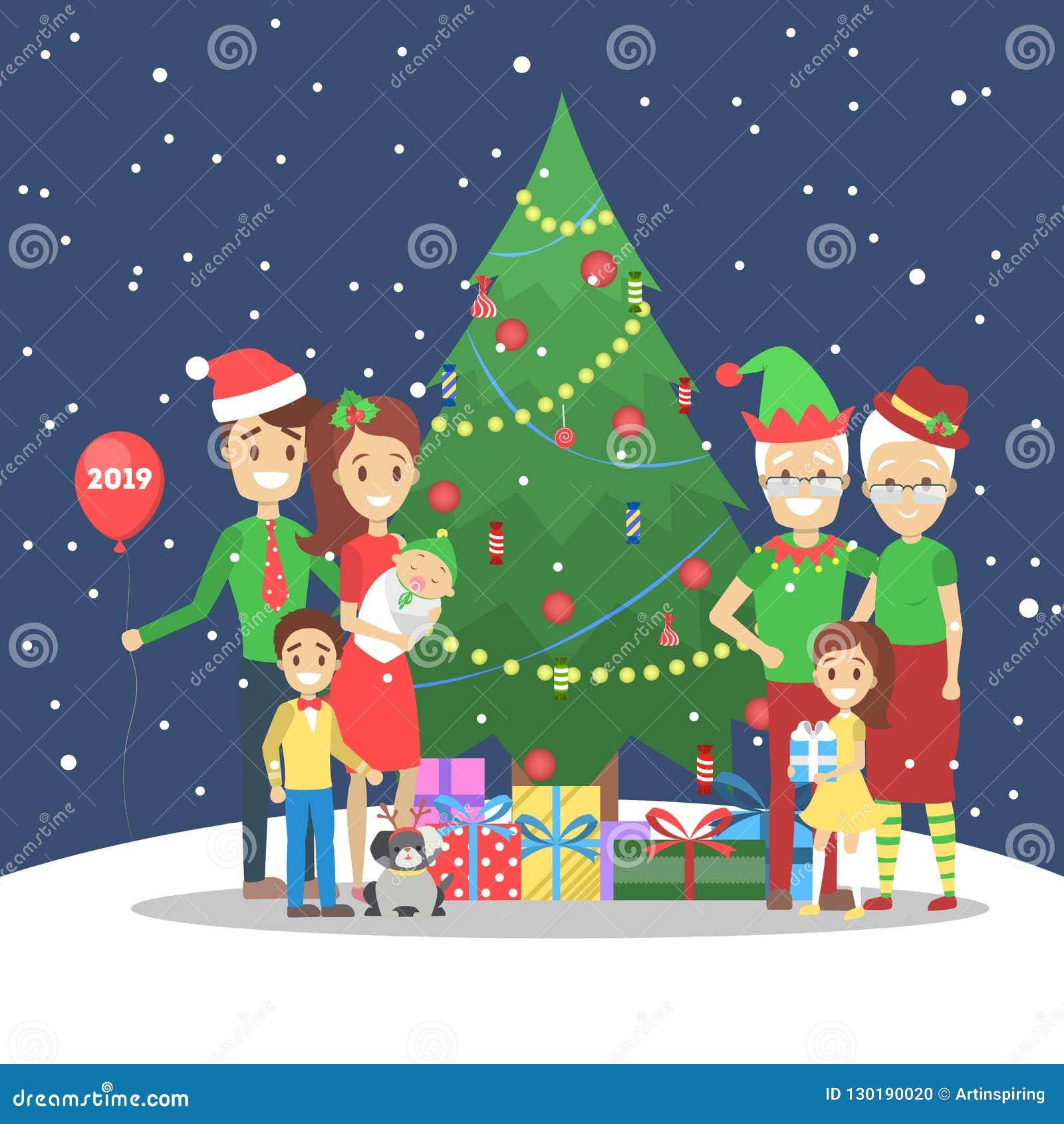 La famille ont l amusement ensemble à l arbre de Noël