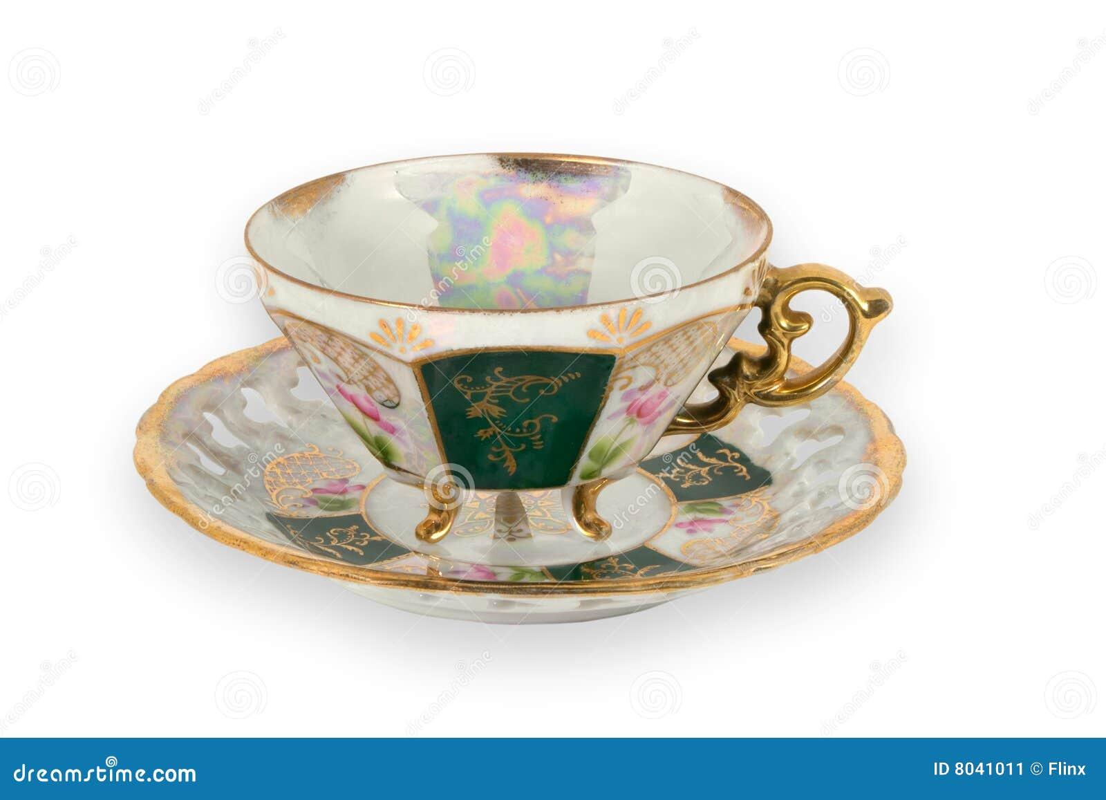 Tasse Fantaisie la fantaisie a doré la tasse de thé image stock - image du dishware