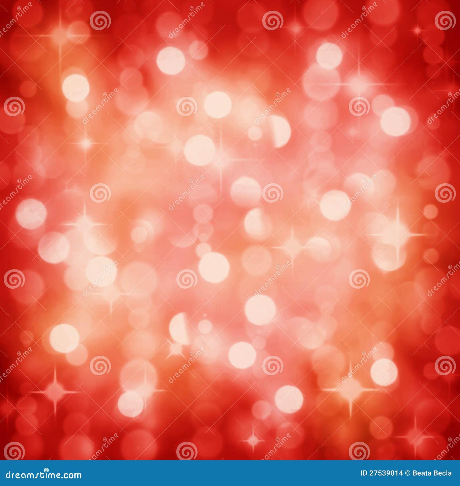 La fiesta de Navidad roja el chispear enciende el fondo