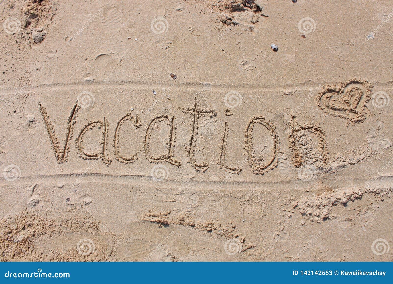 La inscripción en la arena de la playa - vacaciones