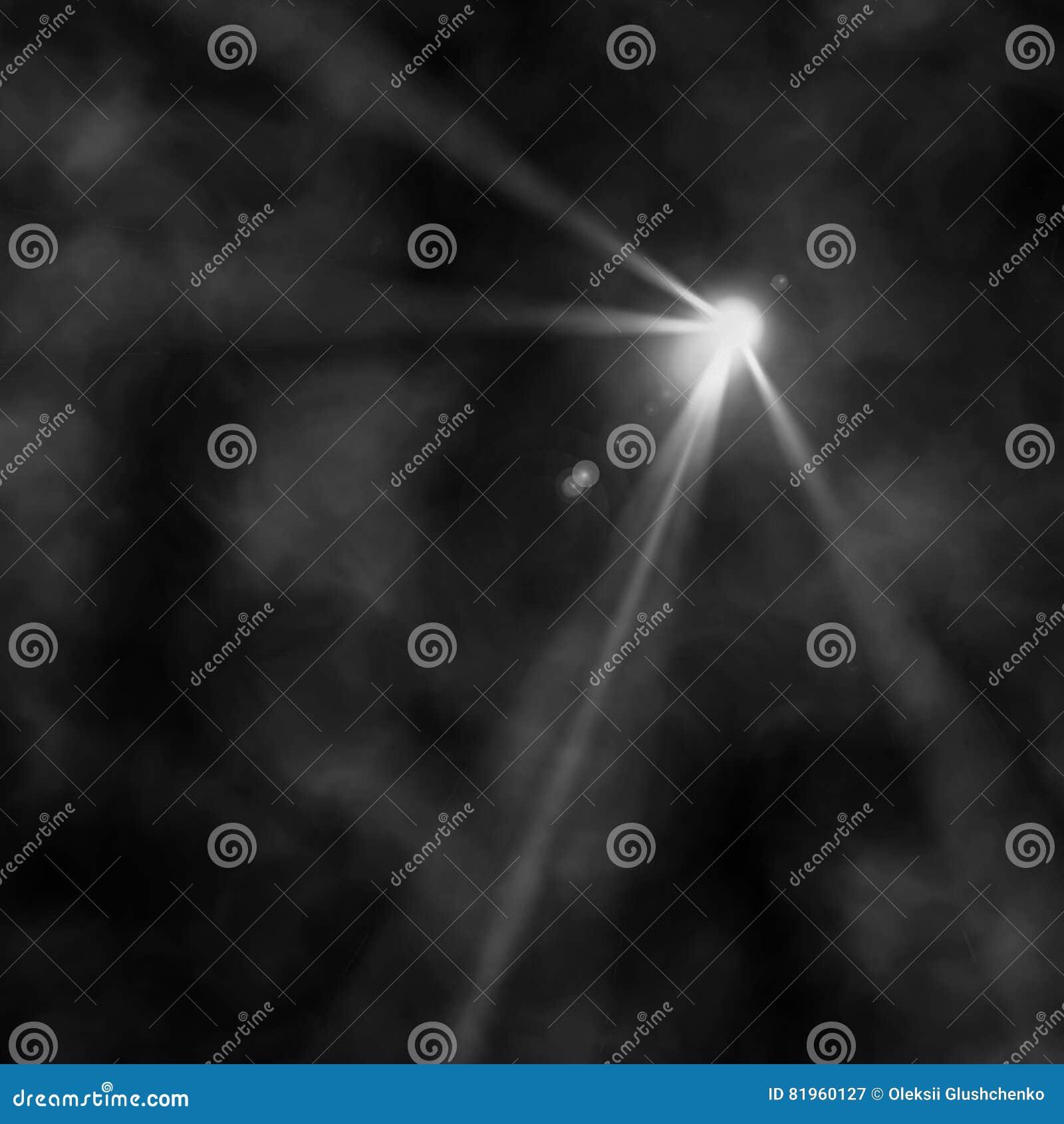 La lumière d un projecteur rayonne par une fumée