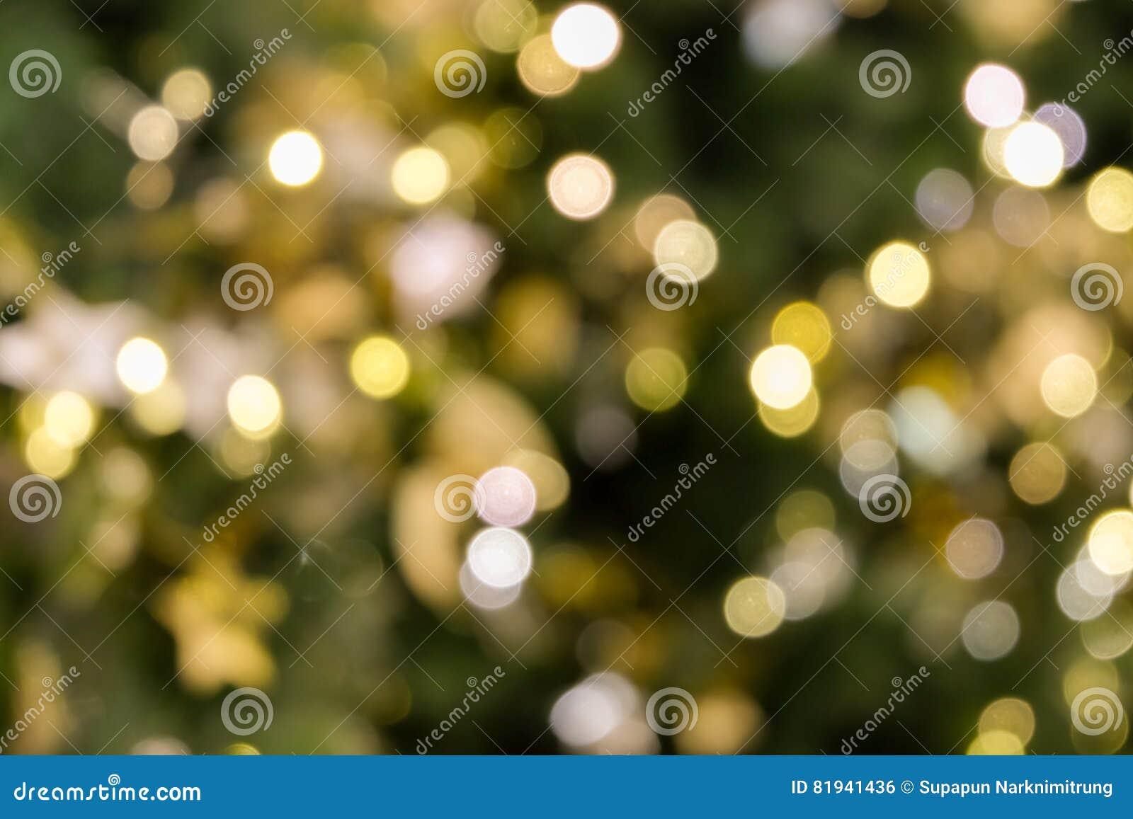 La Luz Del Bokeh Del árbol De Navidad En El Color De Oro Amarillo ...