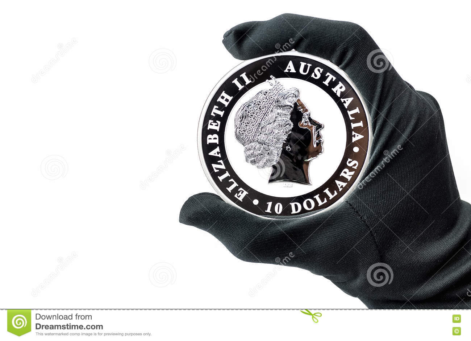 La main dans le gant noir tenant de grands dollars en argent inventent