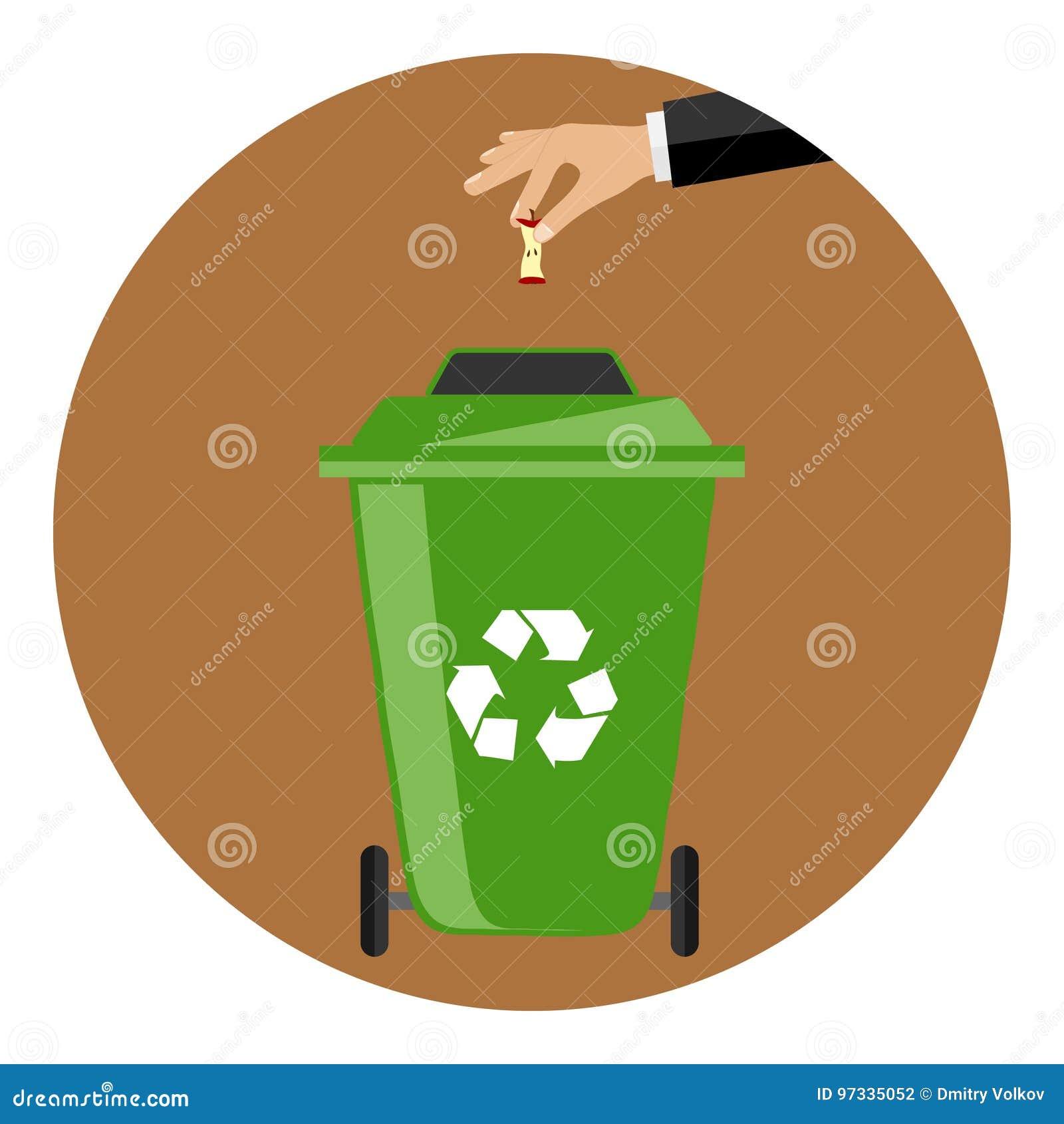 La main jette les déchets dans le récipient