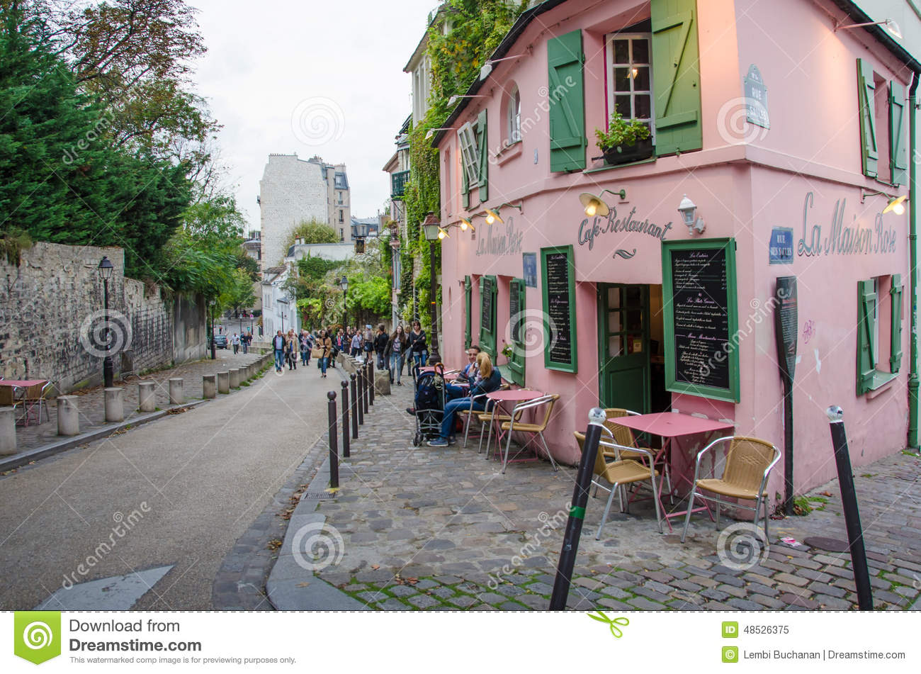 Paris france october 9 2014 a couple is enjoying their leisurely lunch at la maison rose cafe restaurant in the historic montmartre neighborhood