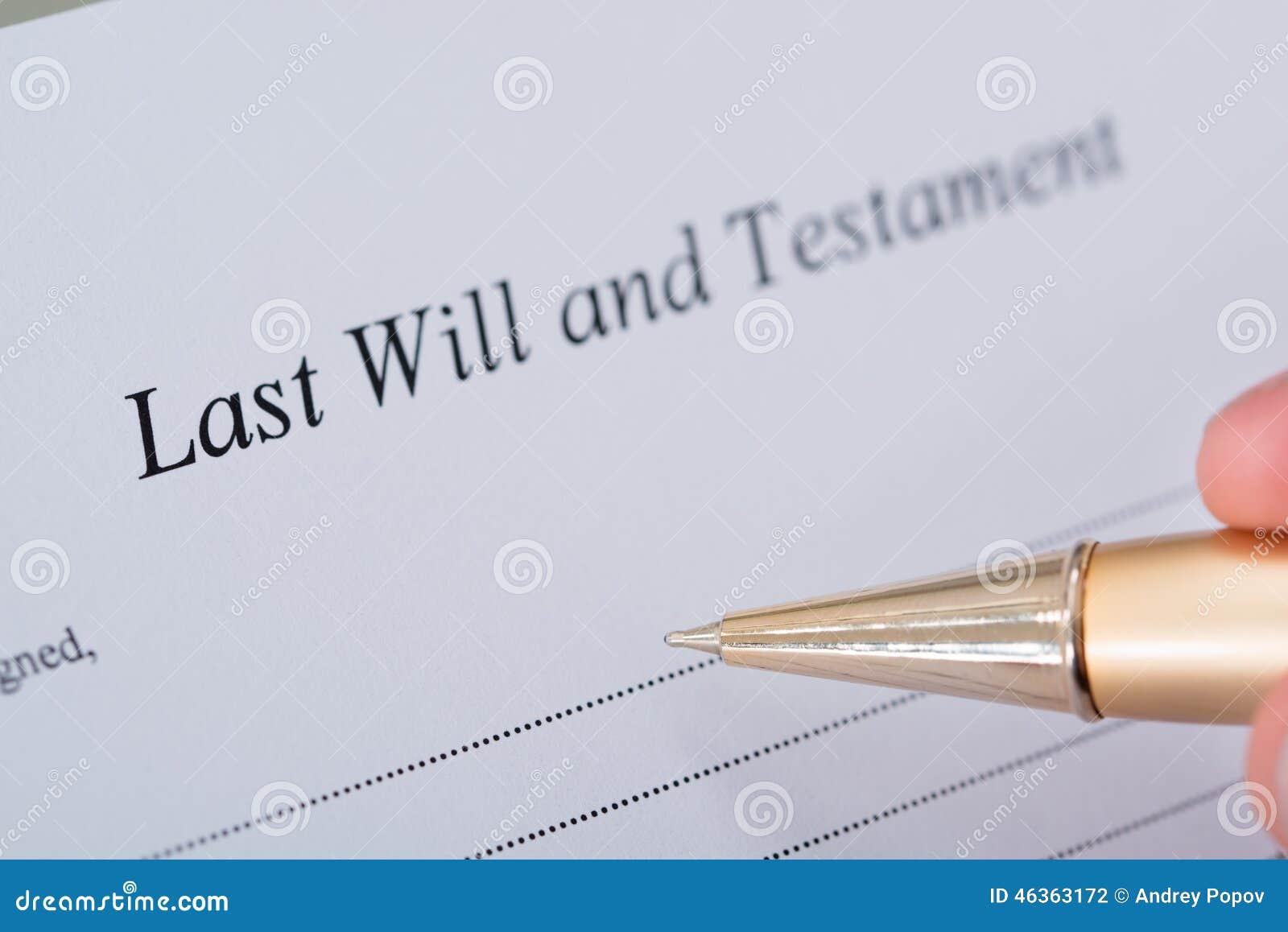 La mano che firmano l ultima volta ed il documento del testamento