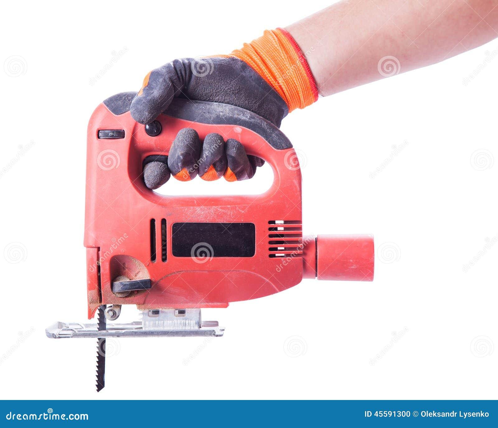La mano del hombre en un guante sostiene una sierra - Sierra electrica de mano ...