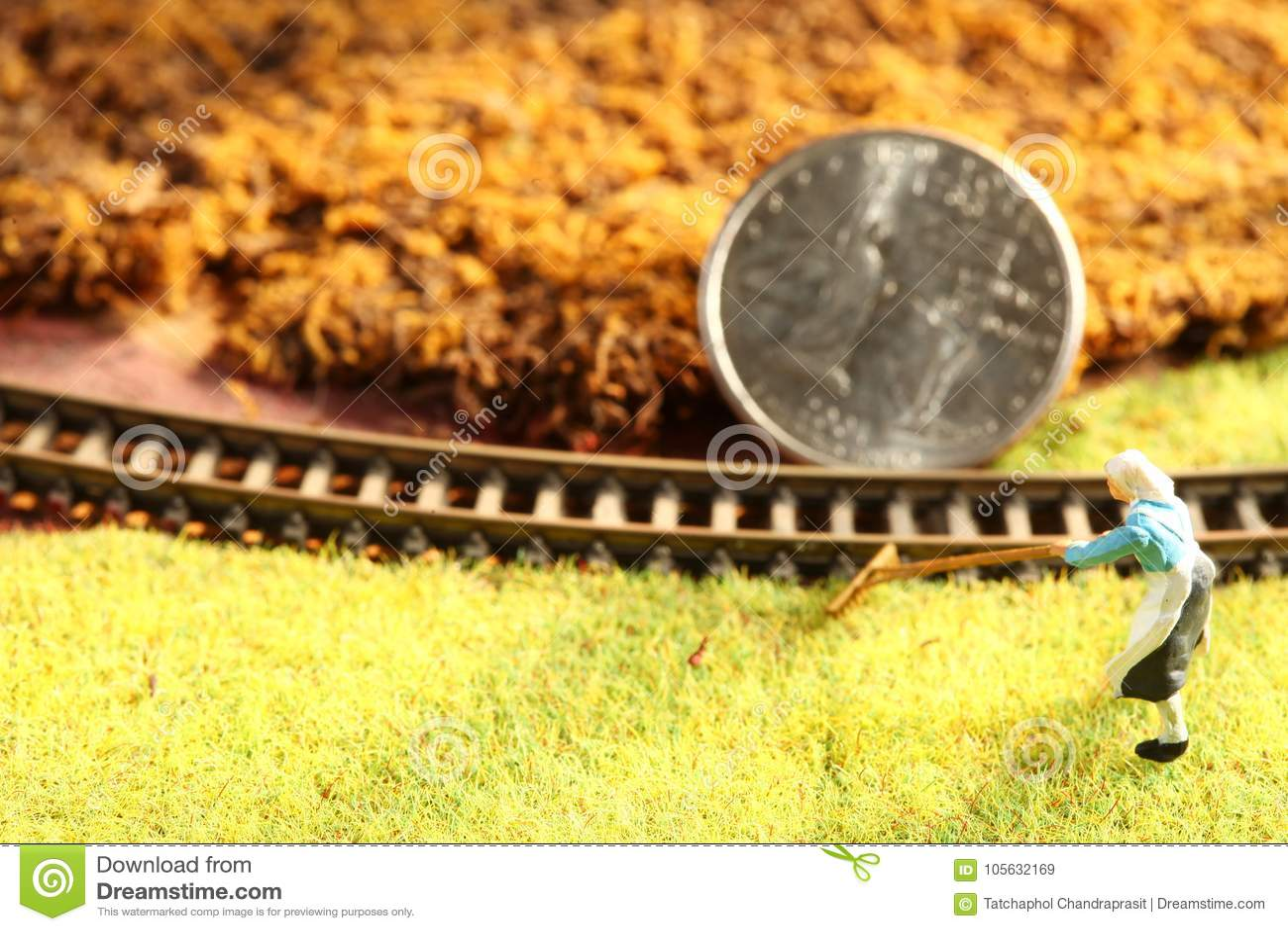 La moneda del dinero puso la escena modelo miniatura del ferrocarril