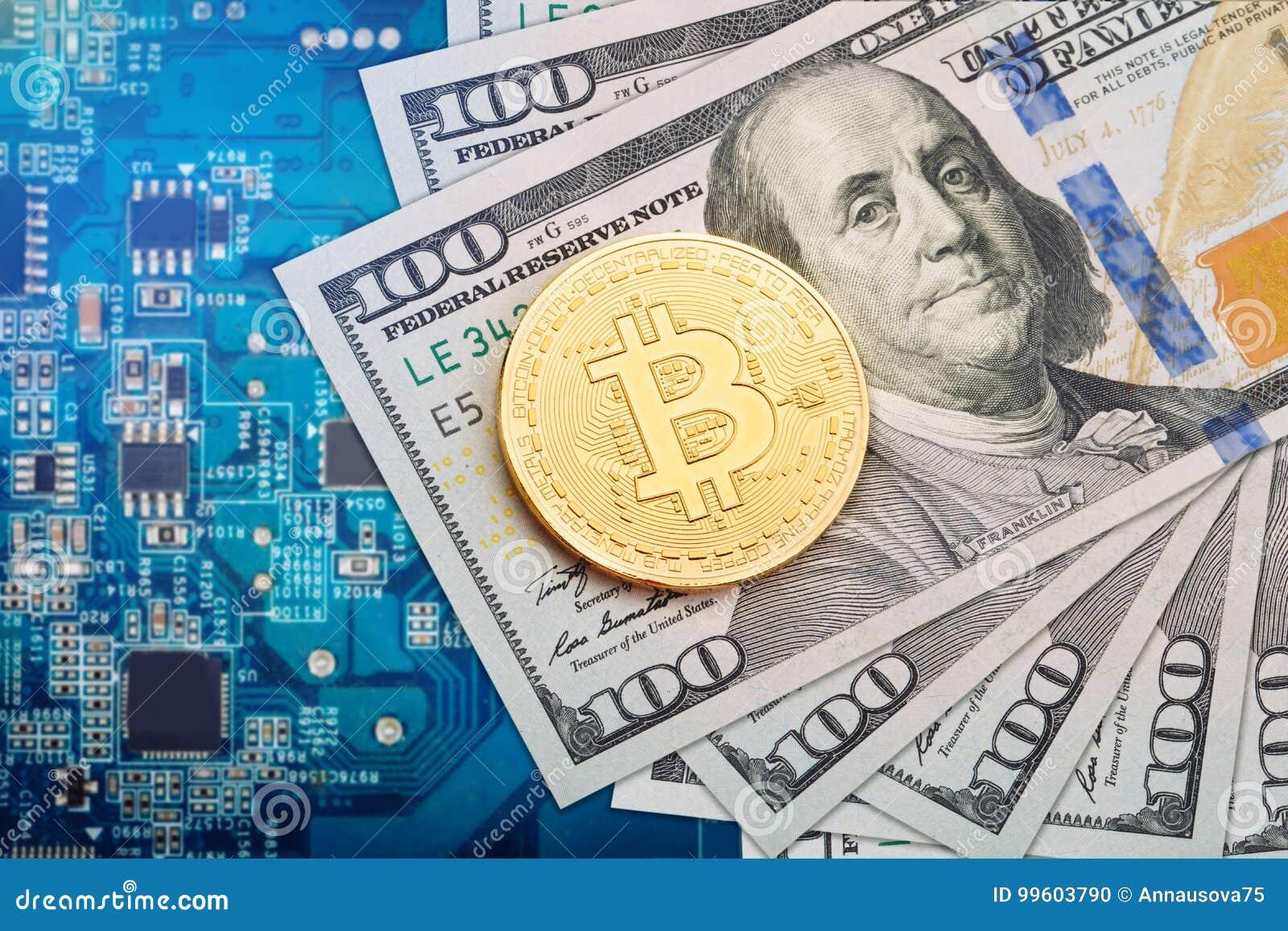 La moneta di bitcoin si trova sui dollari contro lo sfondo della scheda video