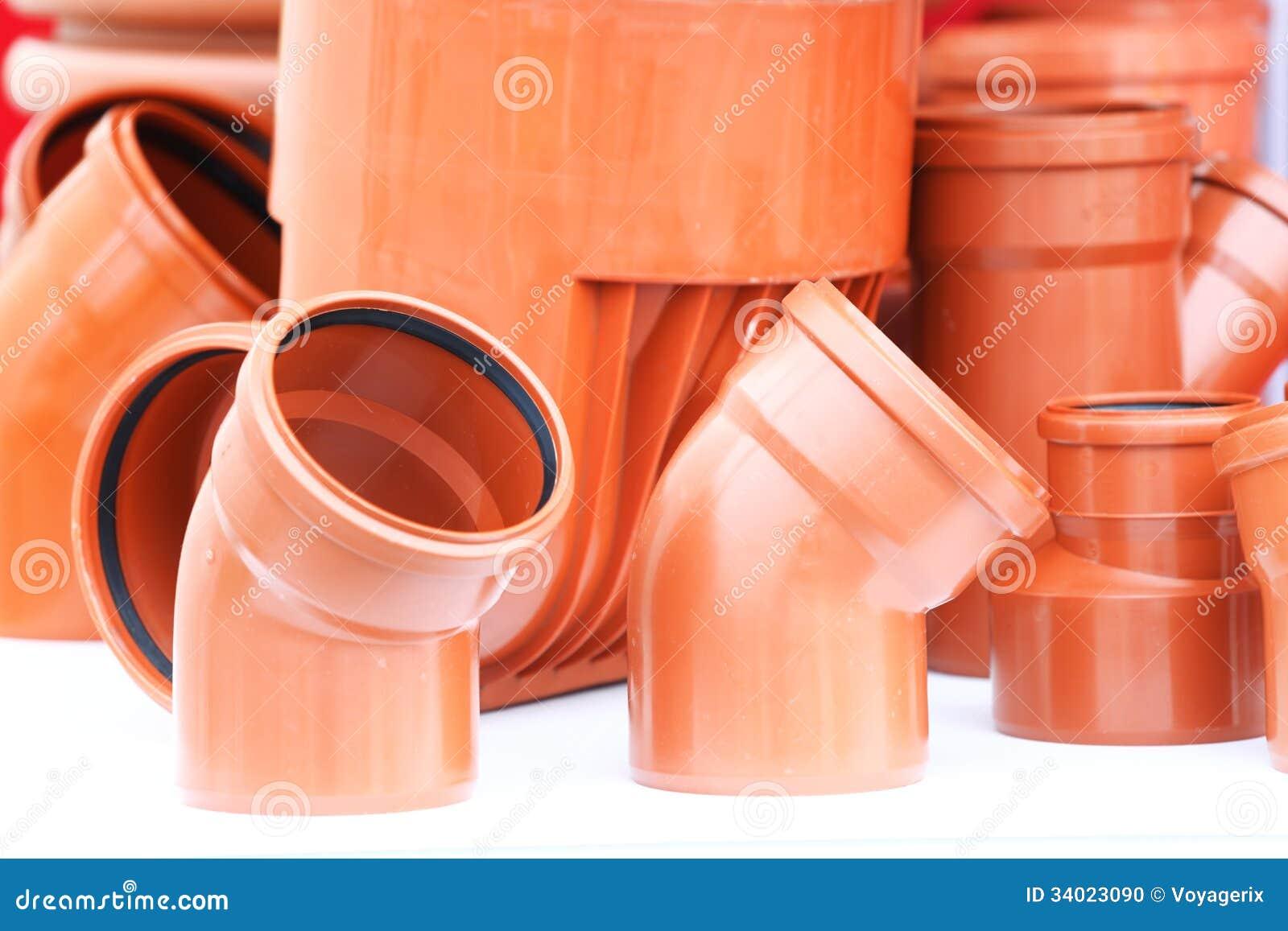 La naranja junta las piezas del pvc de los tubos de - Tubos pvc blanco ...