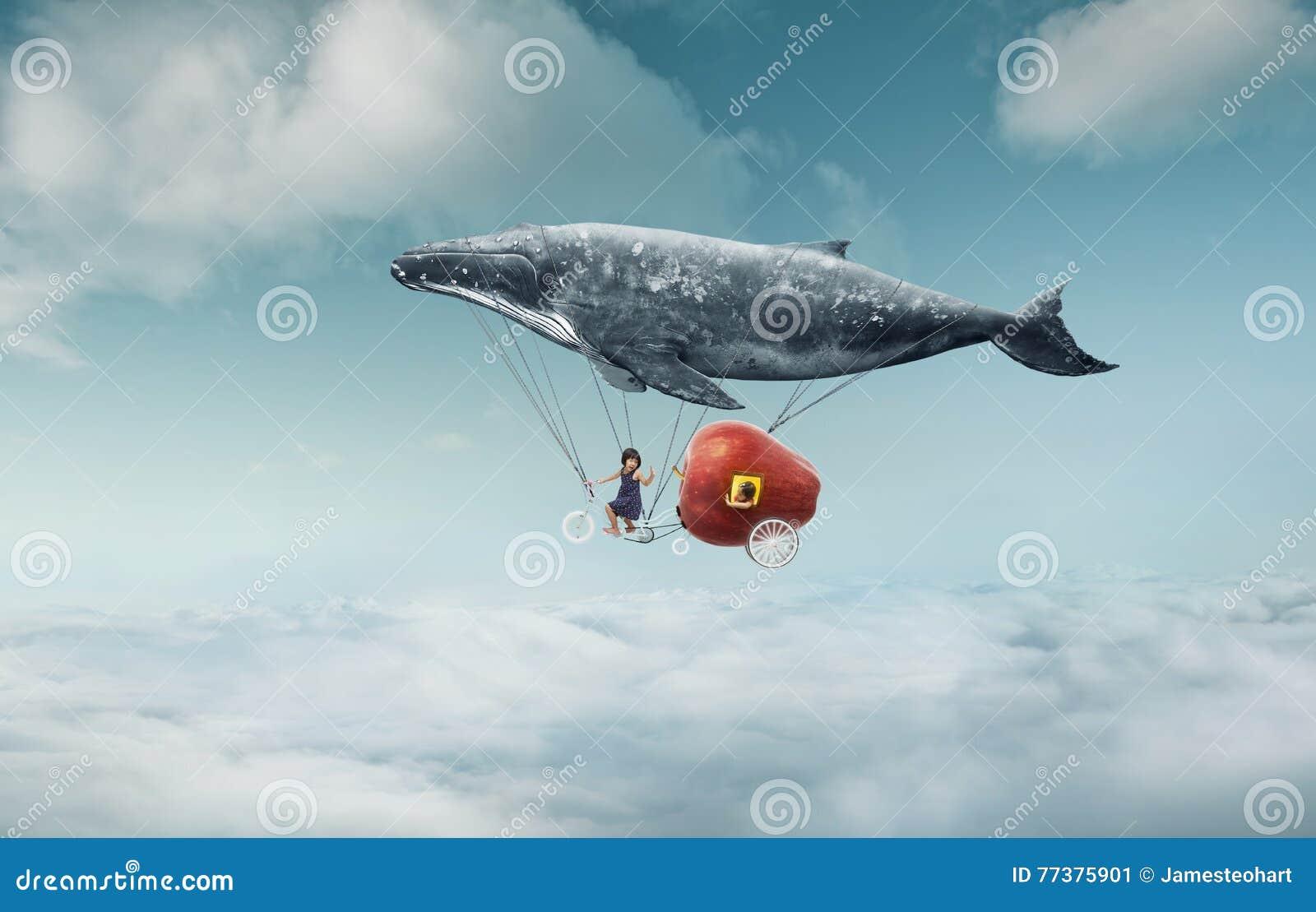 La niña tiene su sueño a viajar en el aire
