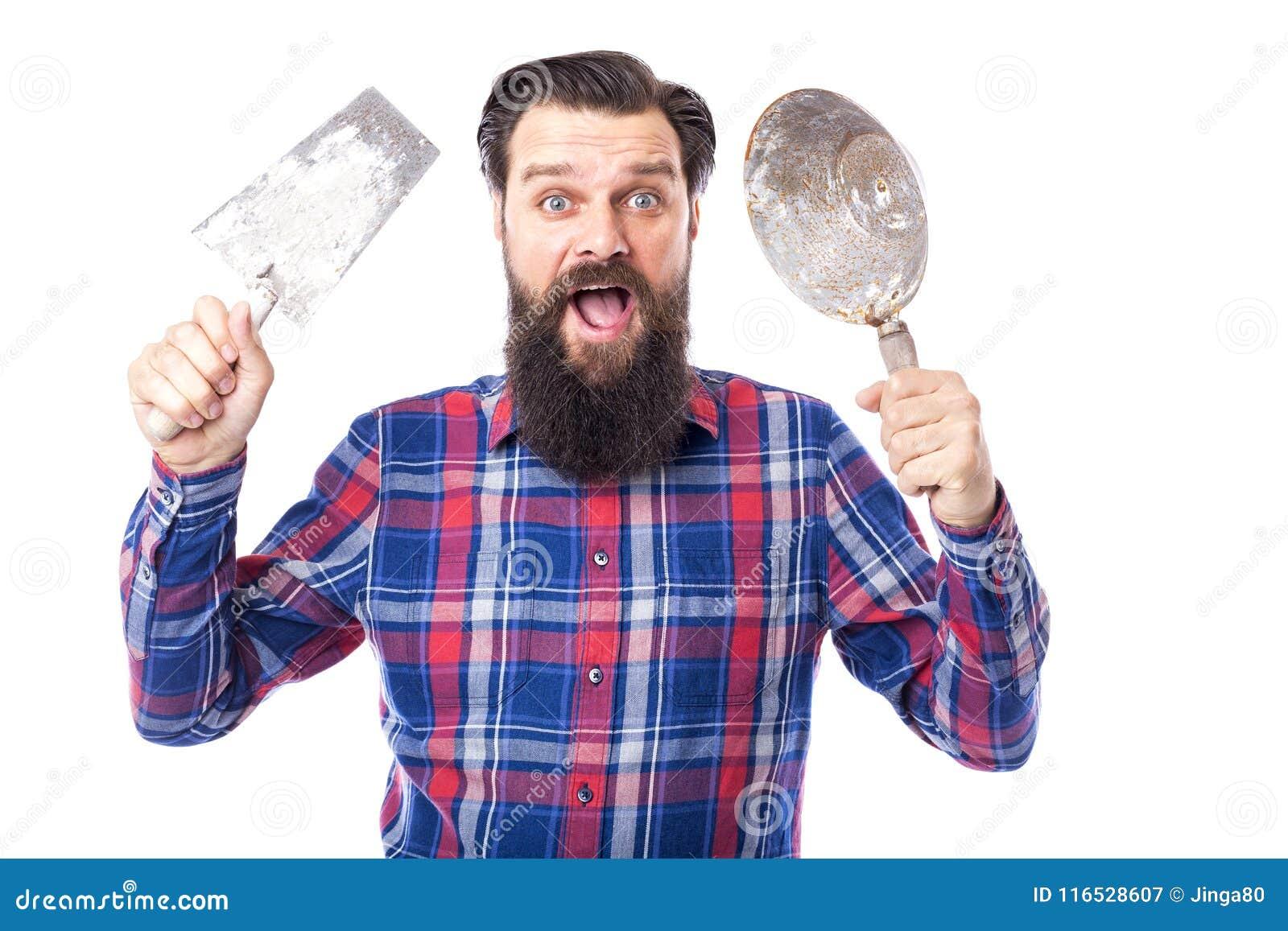 La participation barbue d homme a utilisé des outils de maçonnerie