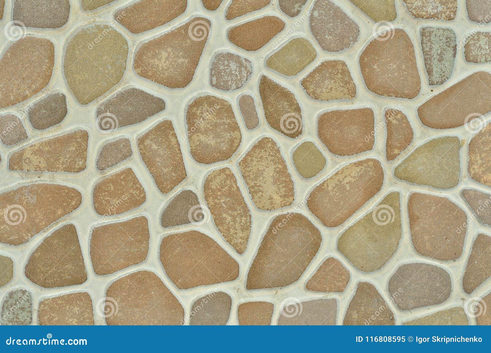 La pietra è una piastrella di ceramica con un modello di pietra rotondo