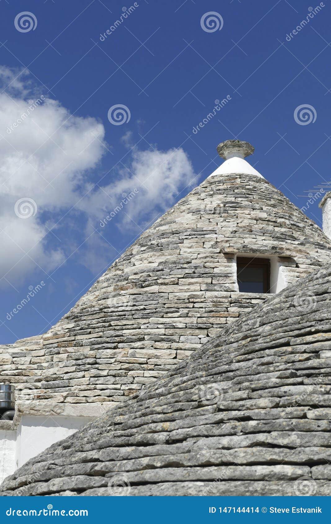 La pietra coned i rooves delle case di trulli