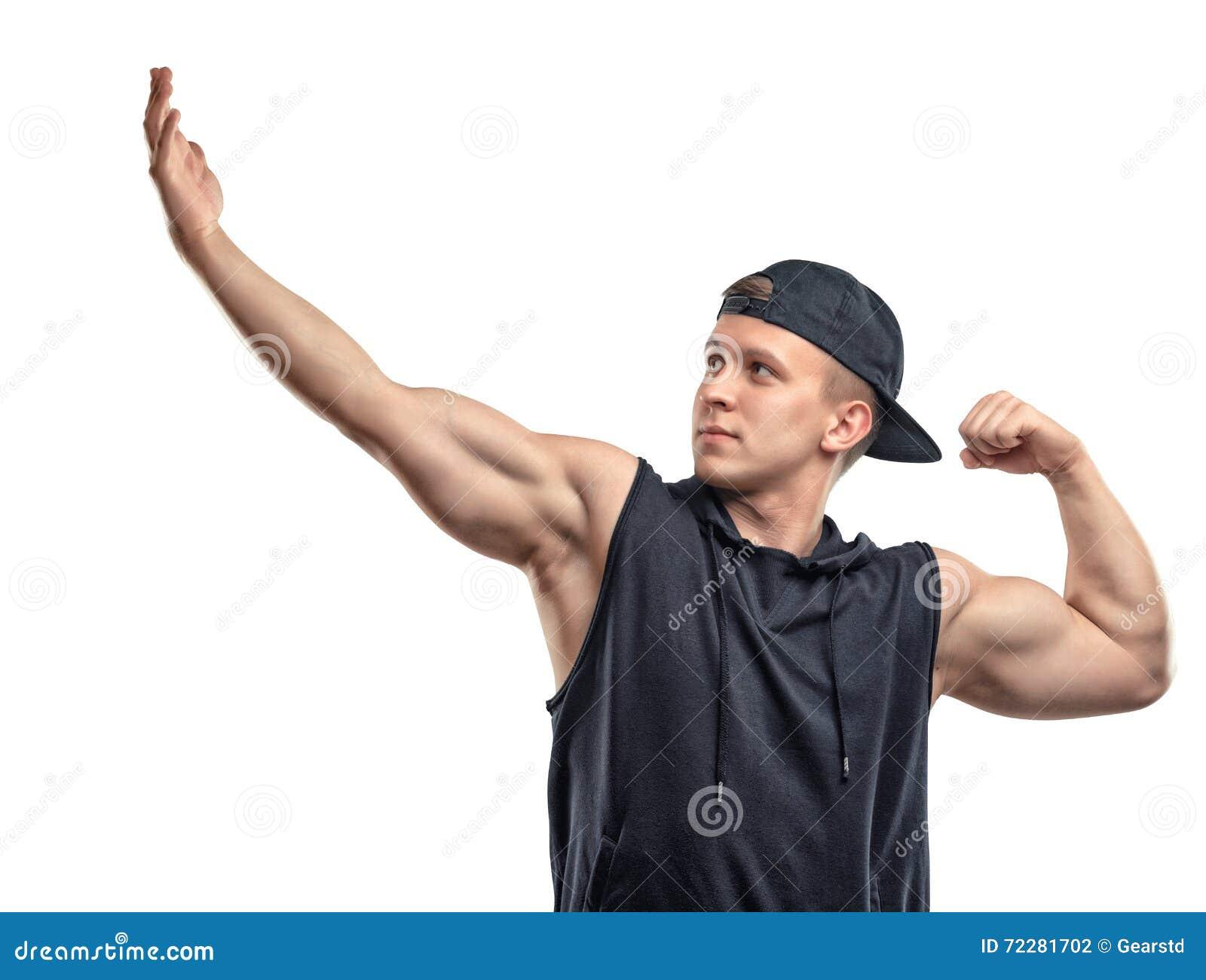 La pose et les expositions d homme de forme physique de Coutout arment des muscles, biceps