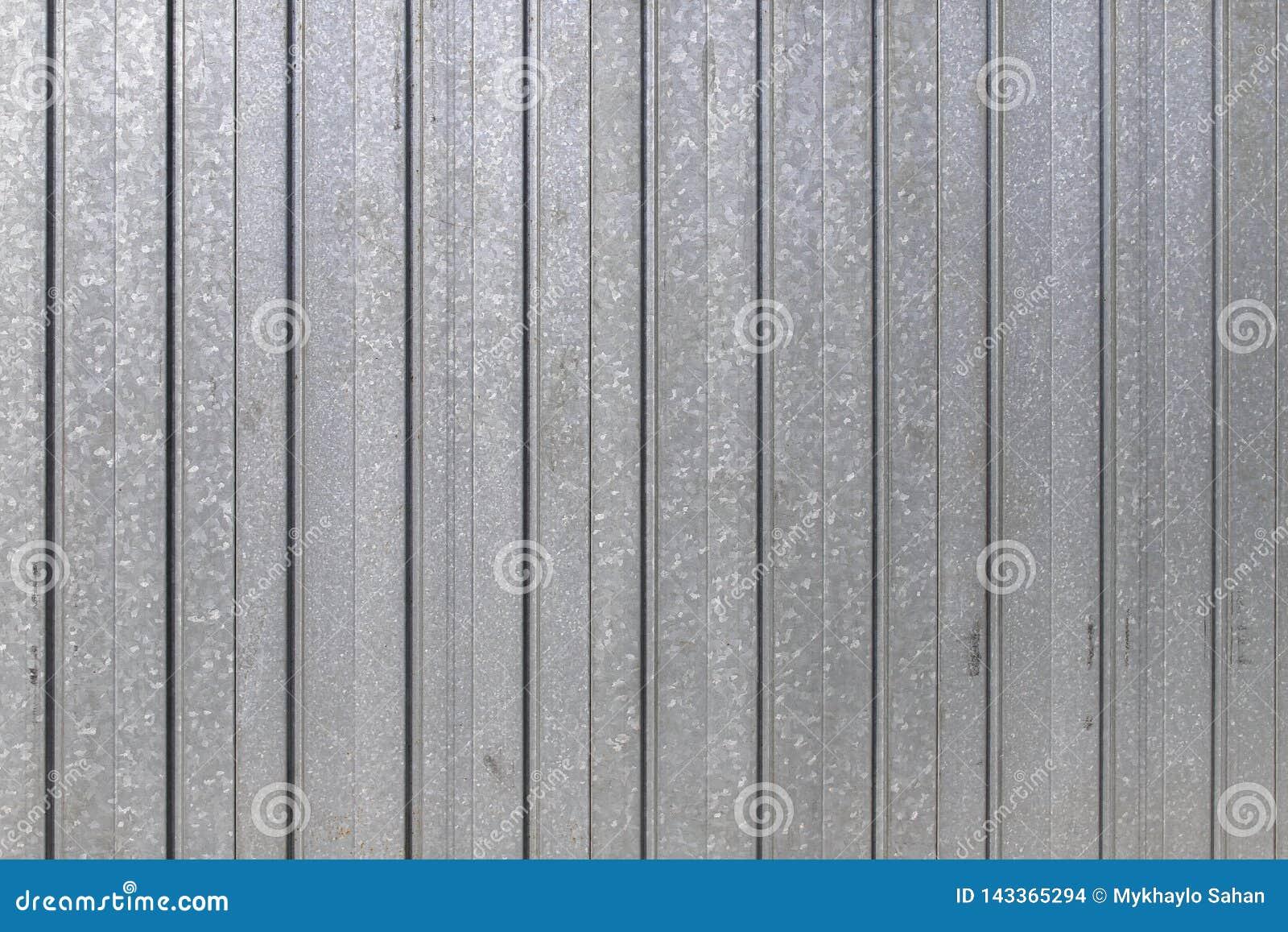 La puerta del garaje peló la textura, fondo de la textura del panel del metal