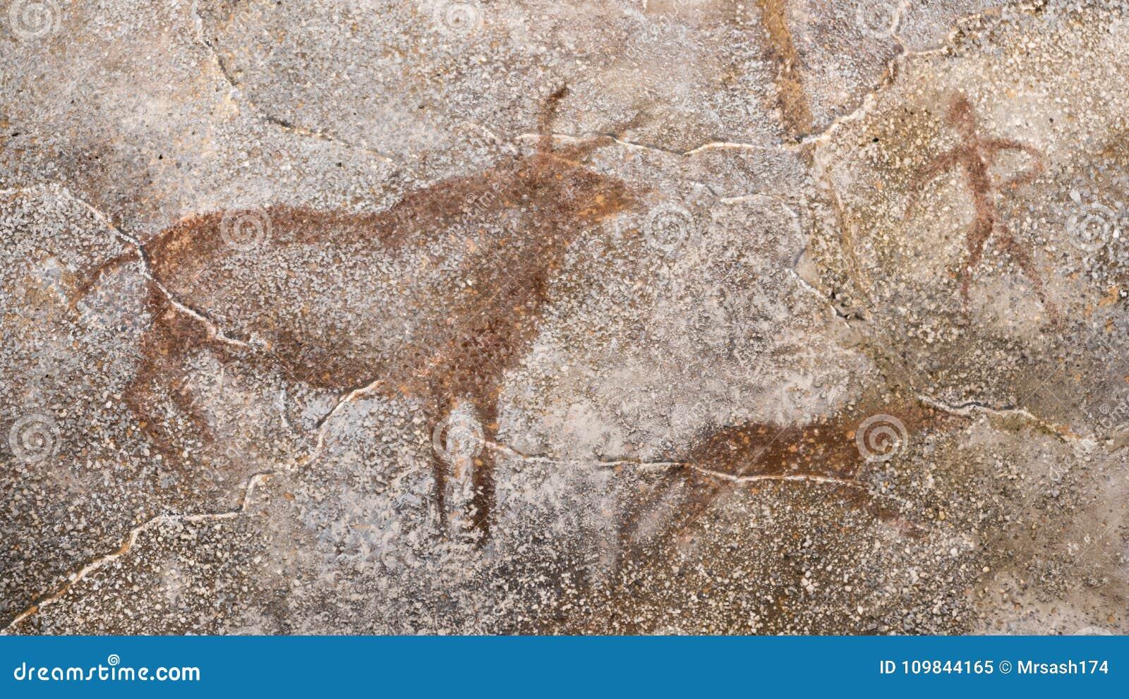La scène d une chasse antique sur un mur de caverne, faite avec ocre