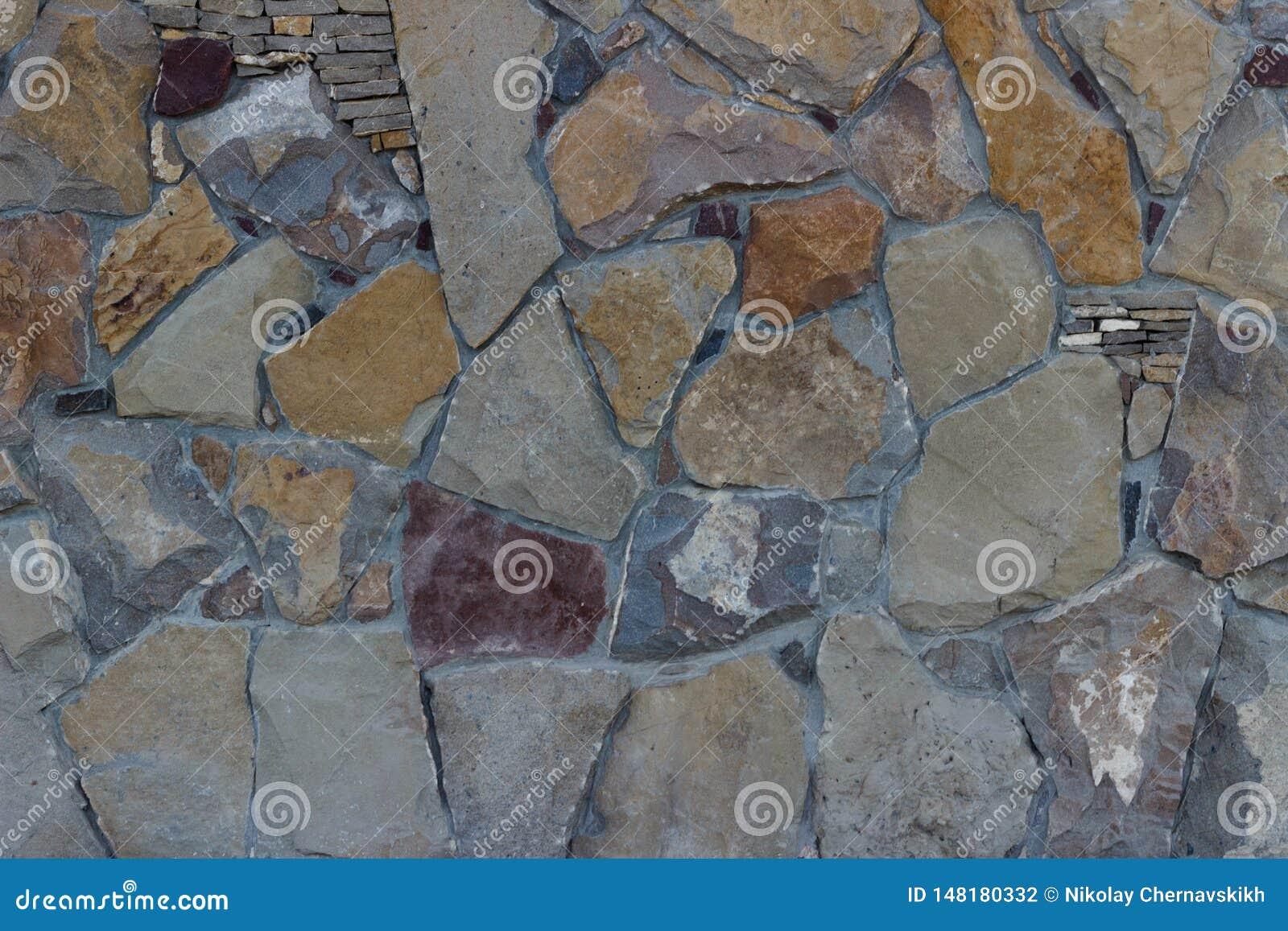 La struttura del frontale differente di progettazione del fondo della parete di pietre ha dettagliato colorato multi
