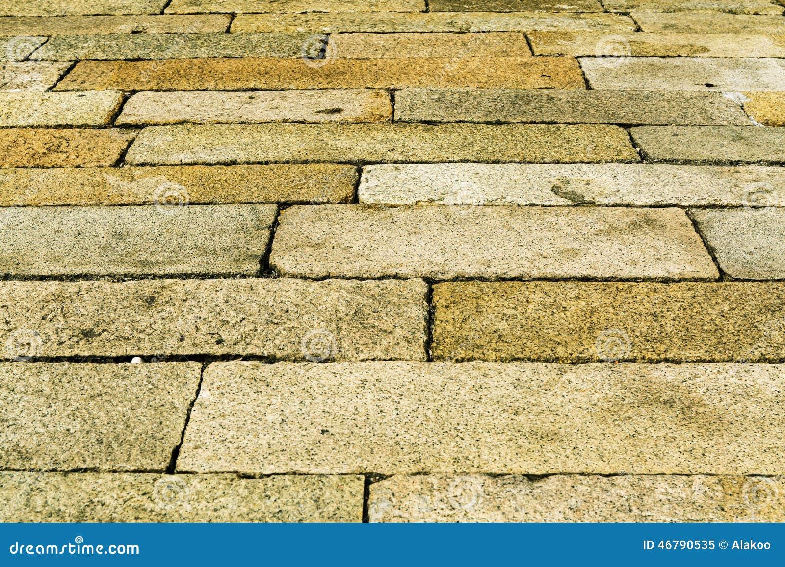 La struttura di superficie di vecchia pietra ha pavimentato la strada, fondo di struttura della pavimentazione