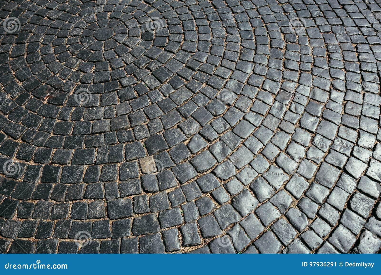 La struttura di vecchia pavimentazione di pietra piastrella i