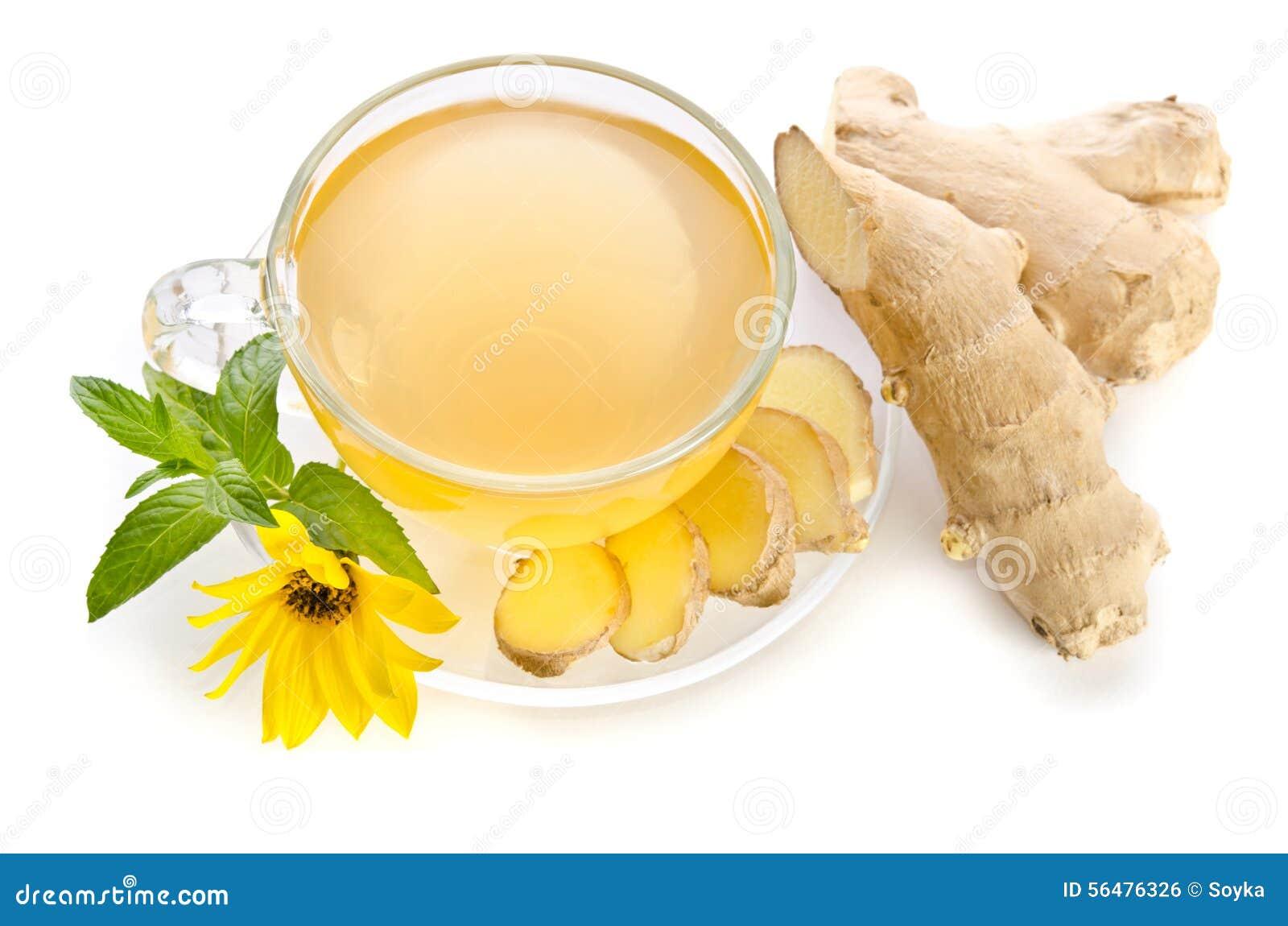 La tasse de thé avec des tranches de gingembre et l Echinacea fleurissent
