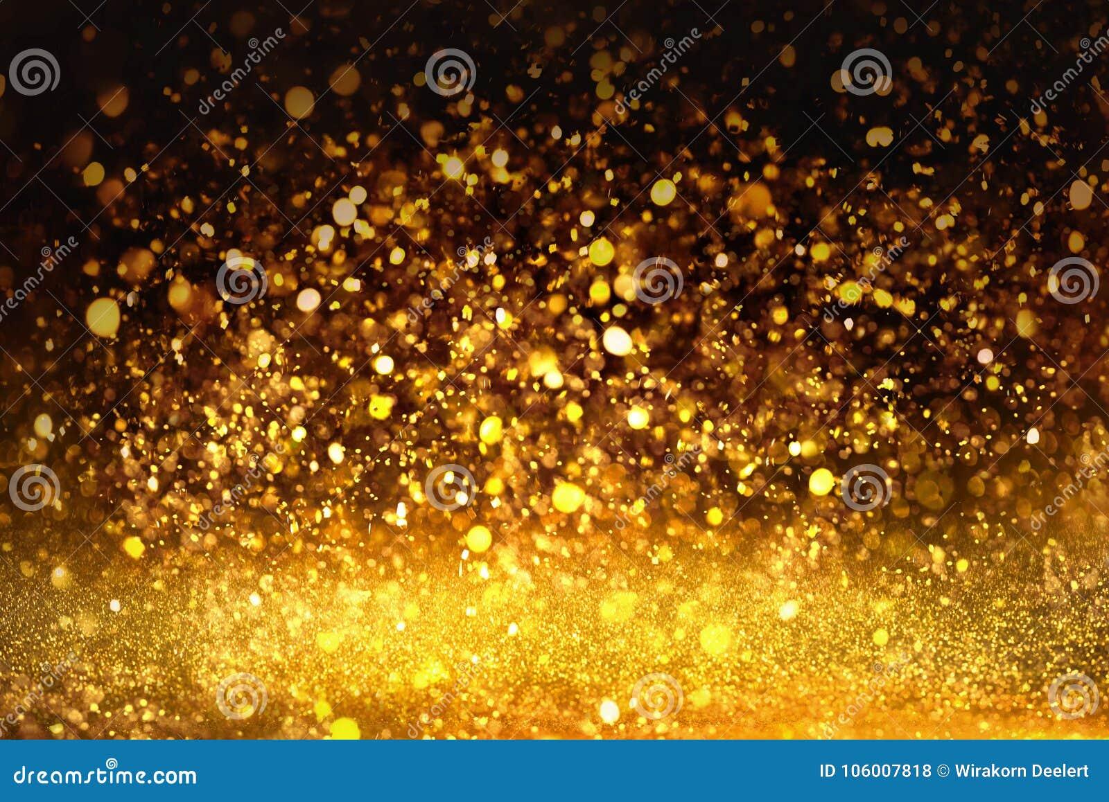 La textura de oro Colorfull del brillo empañó el fondo abstracto para el cumpleaños, el aniversario, la boda, la Noche Vieja o la