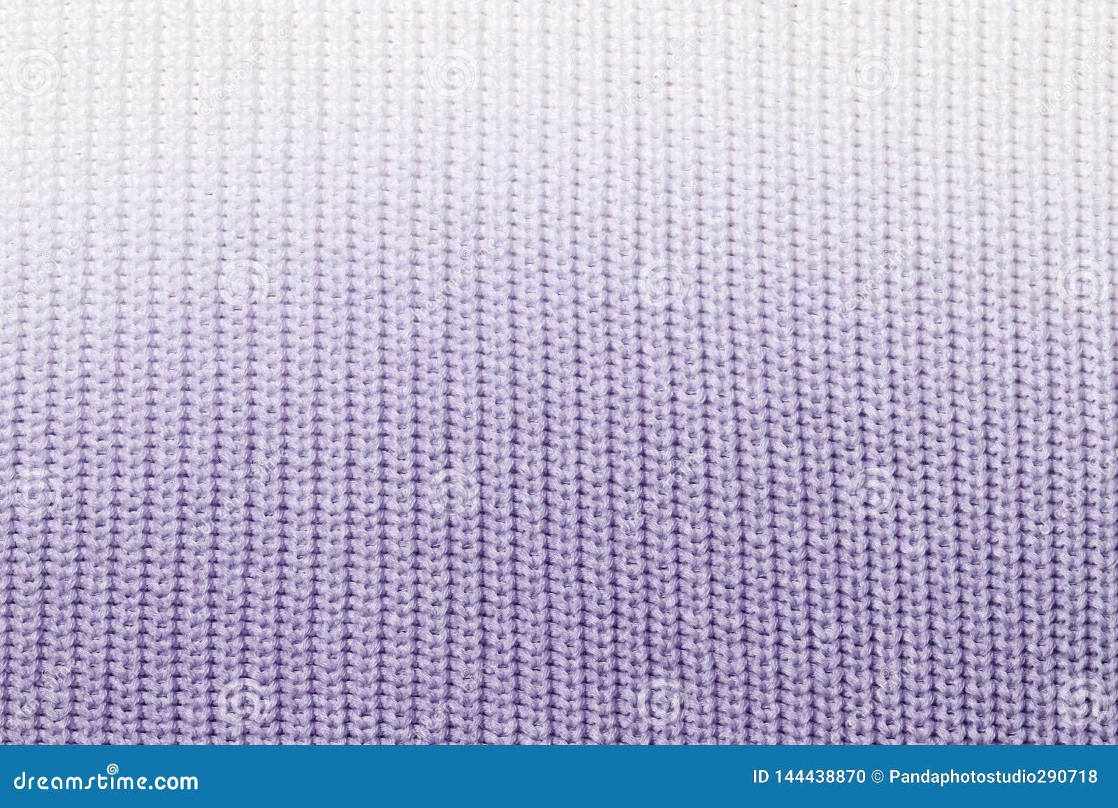 La textura de un azul hecho punto de la tela de lana