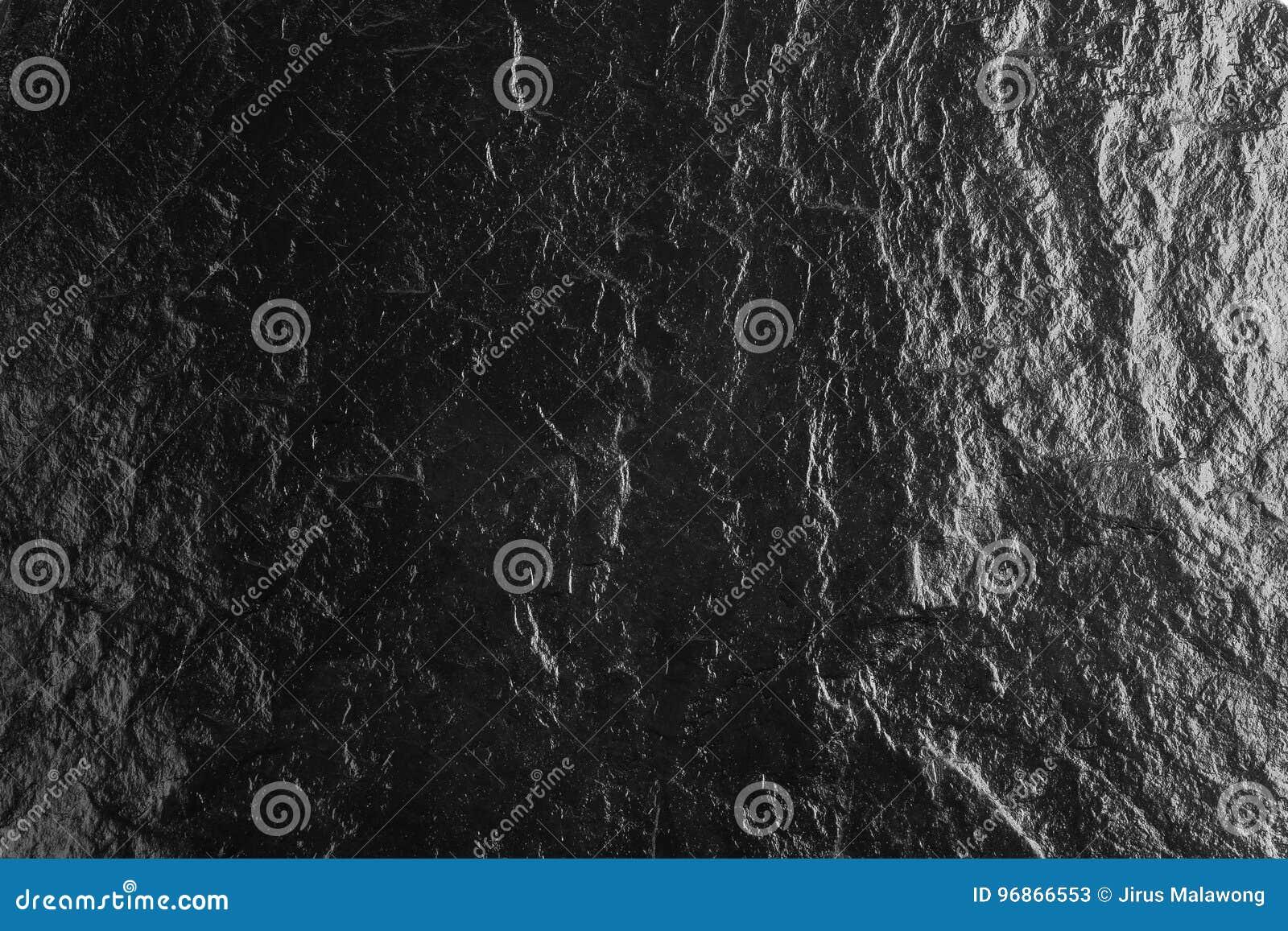 La texture de pierre de dessus de table et le fond noirs, surface de lustre