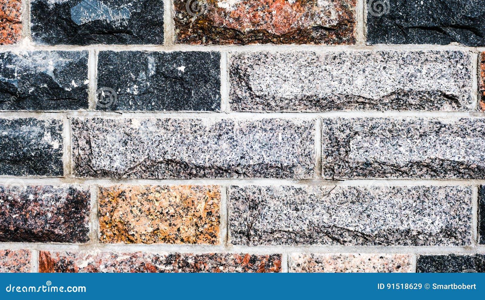 Pierre De Parement En Granit la texture sans couture, fond, lapident garni des murs de