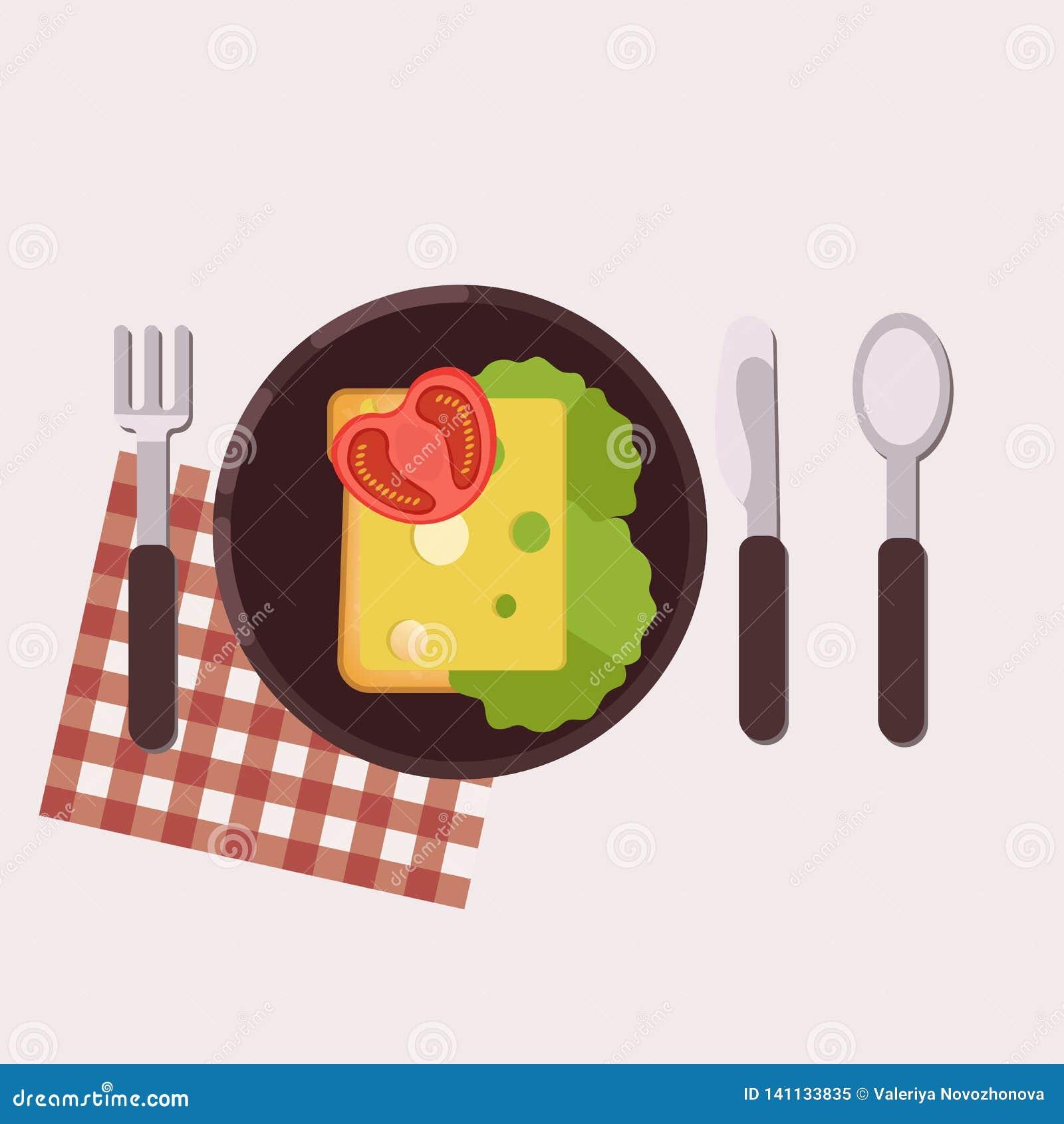 La tostada con queso, mantequilla, el tomate y la ensalada verde sirvió en una placa con la bifurcación, el cuchillo, la cuchara