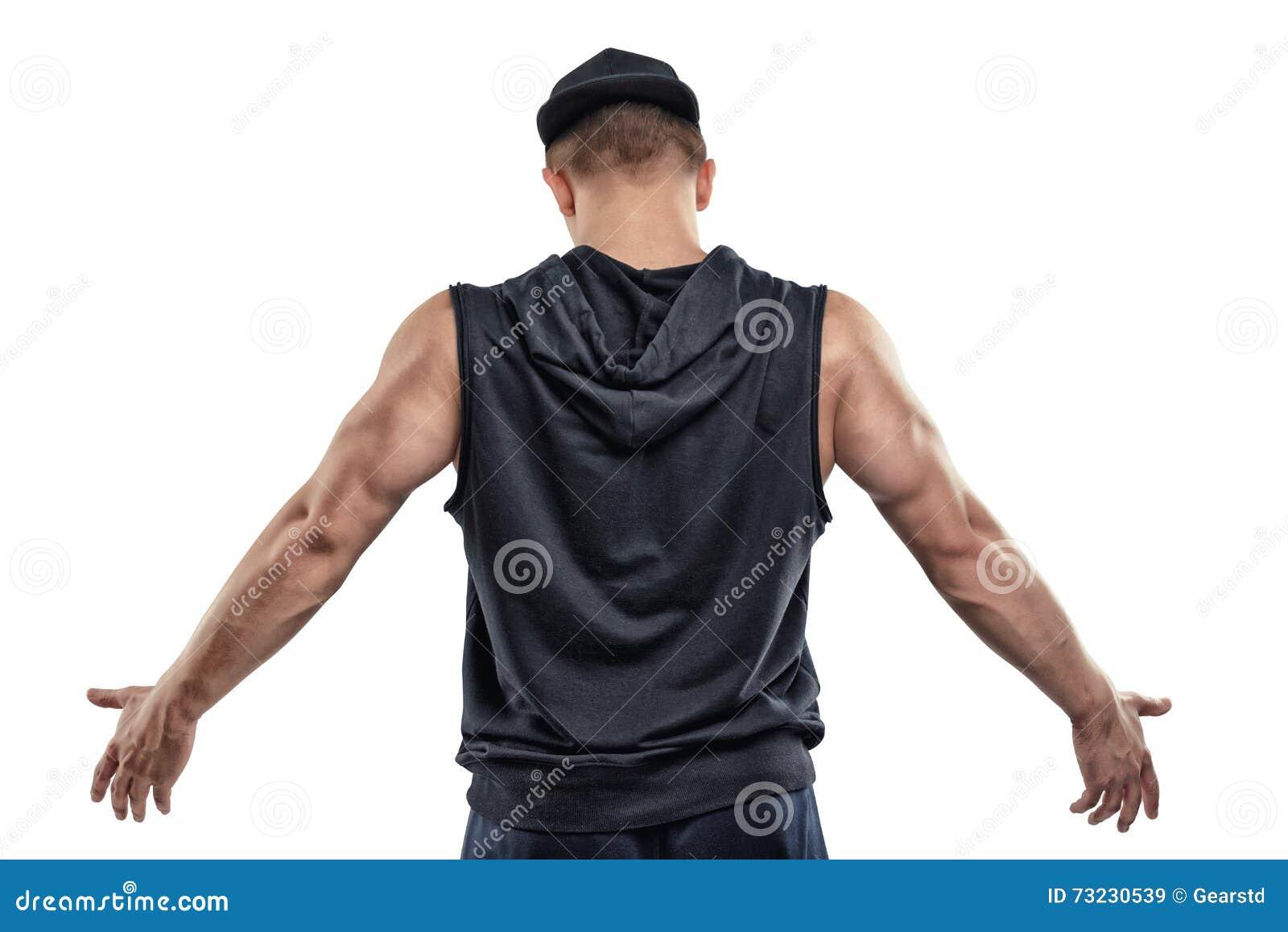 La vue arrière de la pose d isolement d homme de forme physique et les expositions arment des muscles