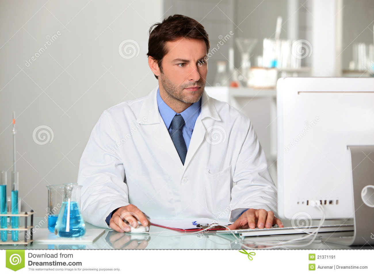 lab technician studying results on a computer stock image - image, Human Body