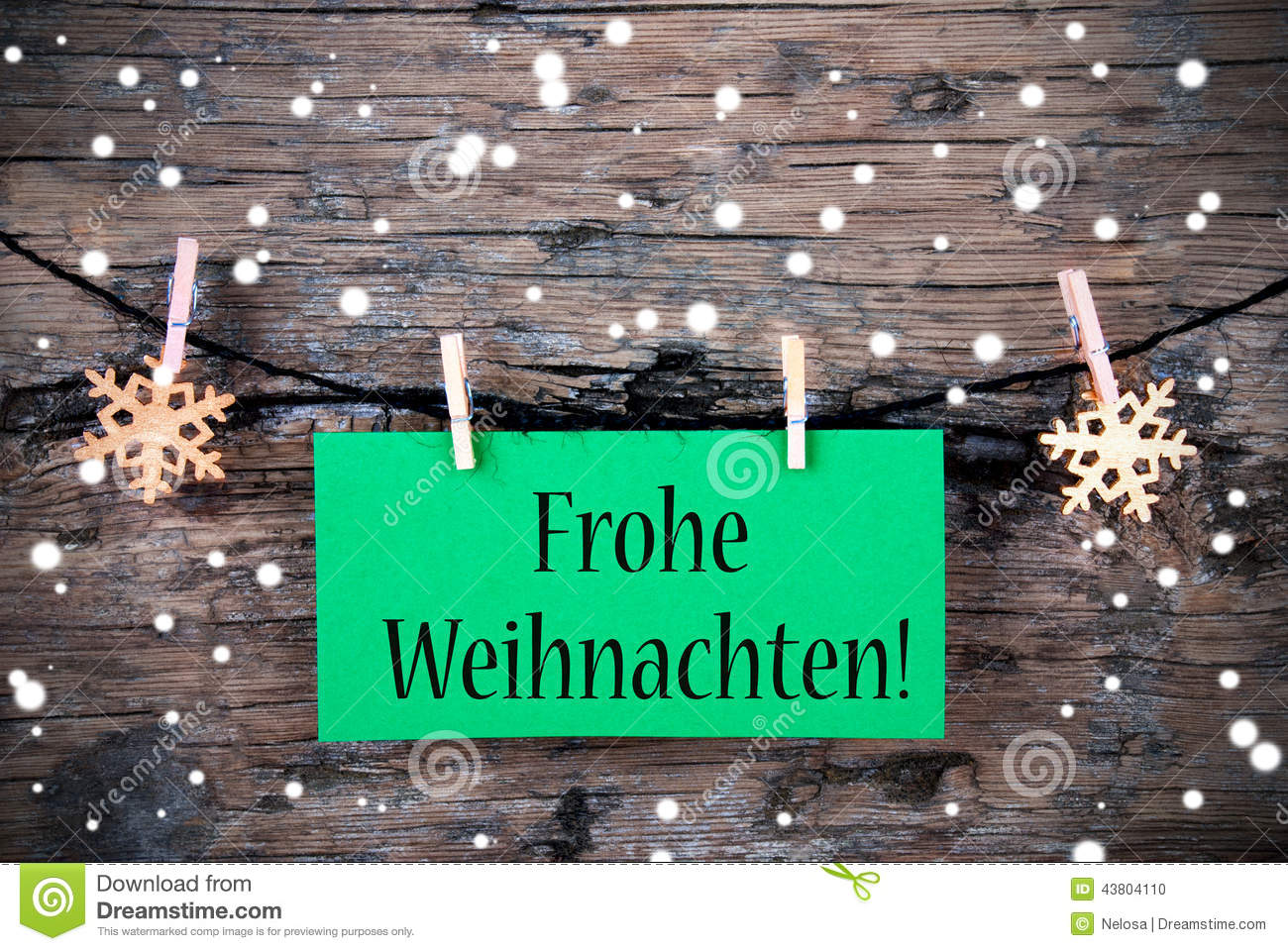 Frohe Weihnachten Shabby.Label With Frohe Weihnachten Snowy Background Stock Photo