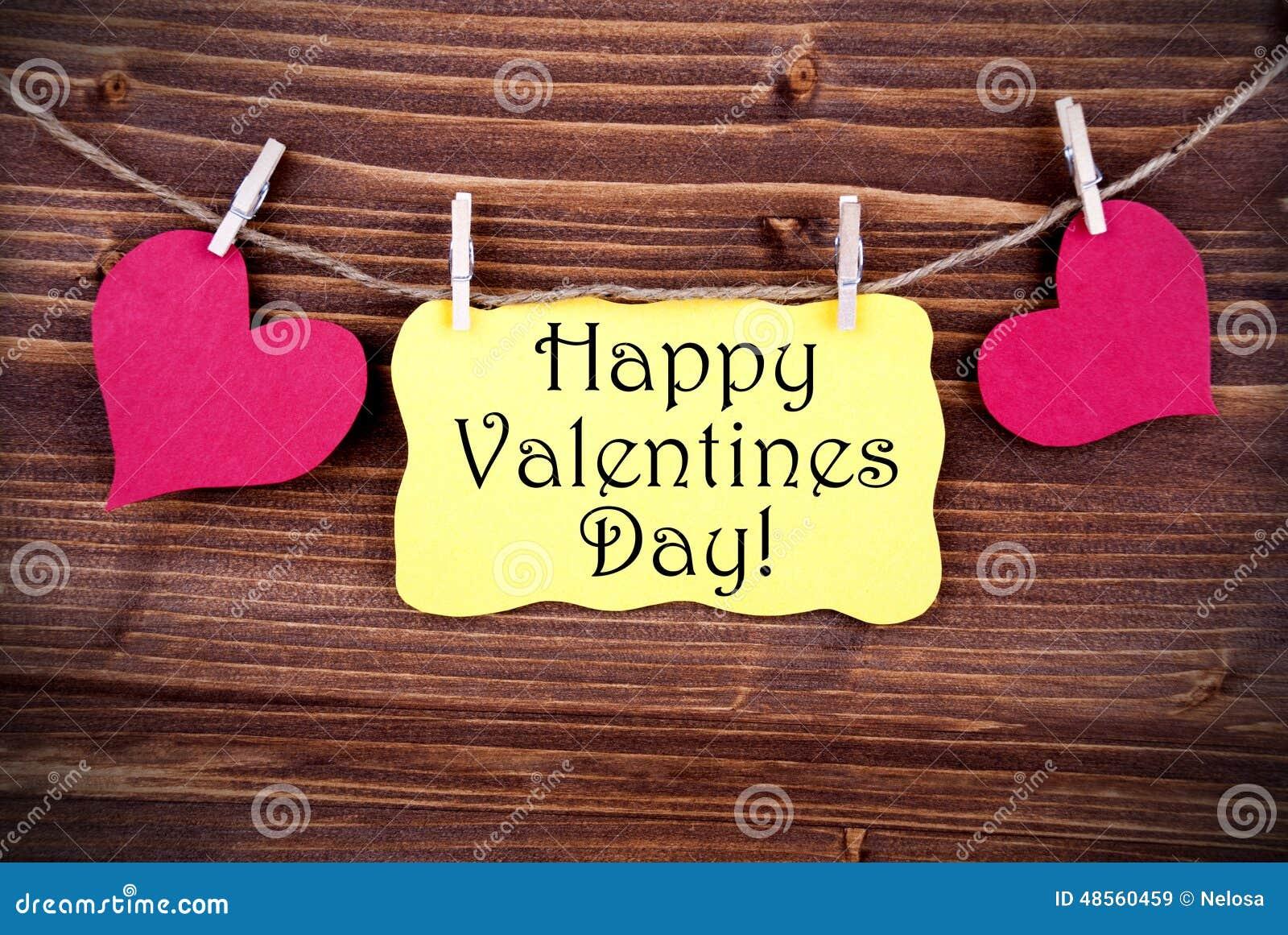 Label jaune avec le jour de valentines heureux