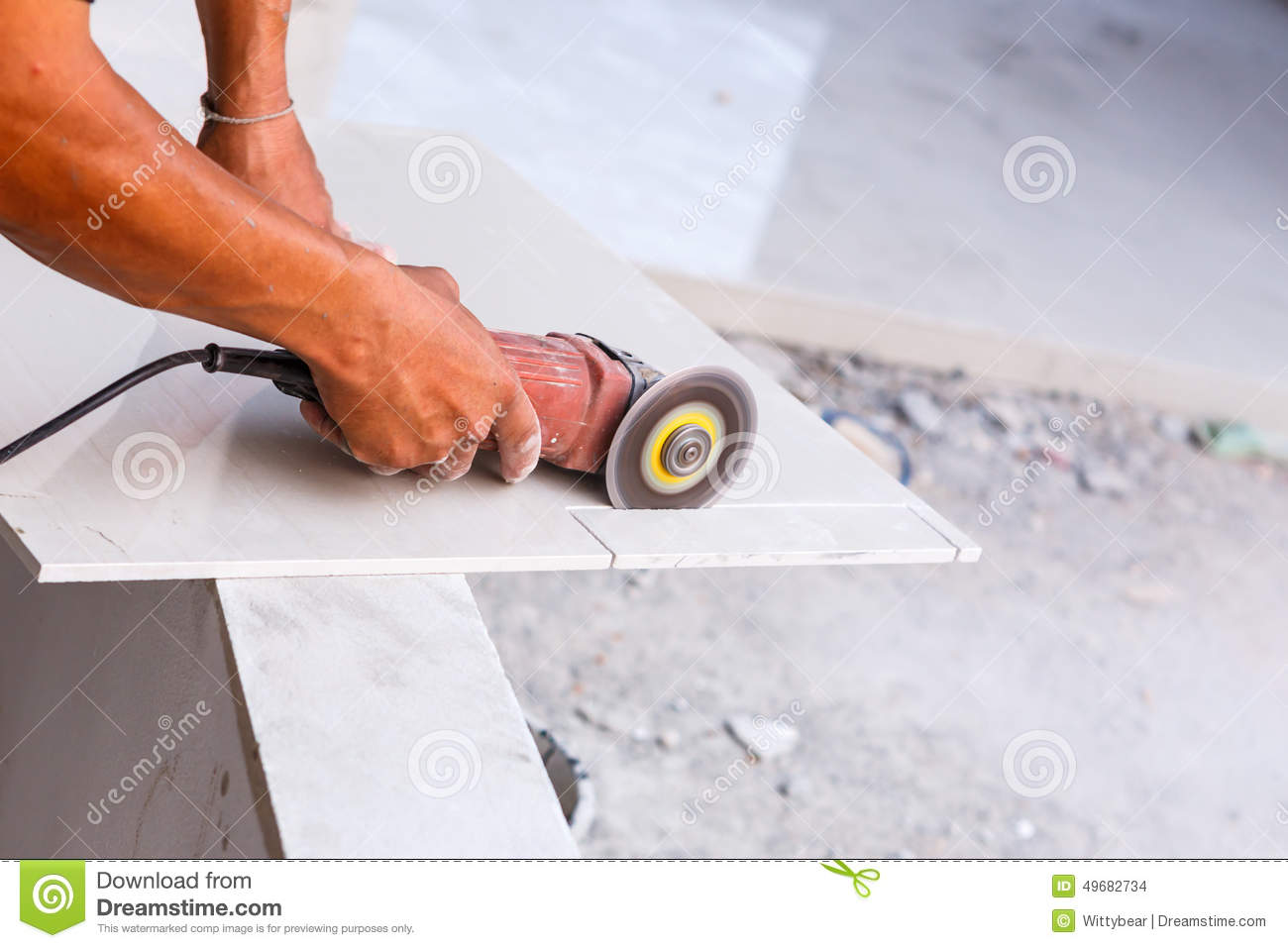 Labor cutting tile floor for new house building stock photo labor cutting tile floor for new house building dailygadgetfo Images