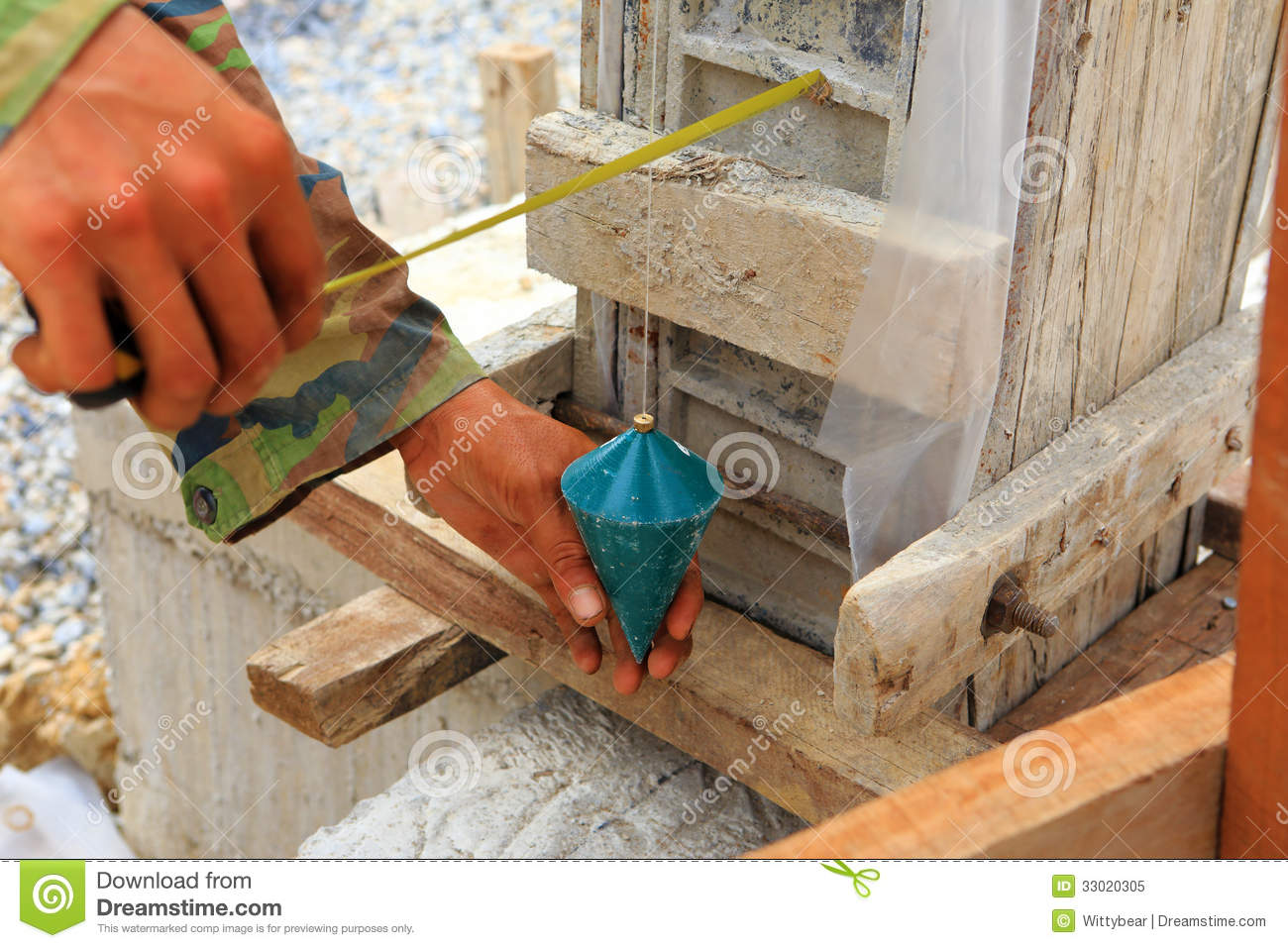 Labor Man Using A Plumb Bob For Check Mason Background