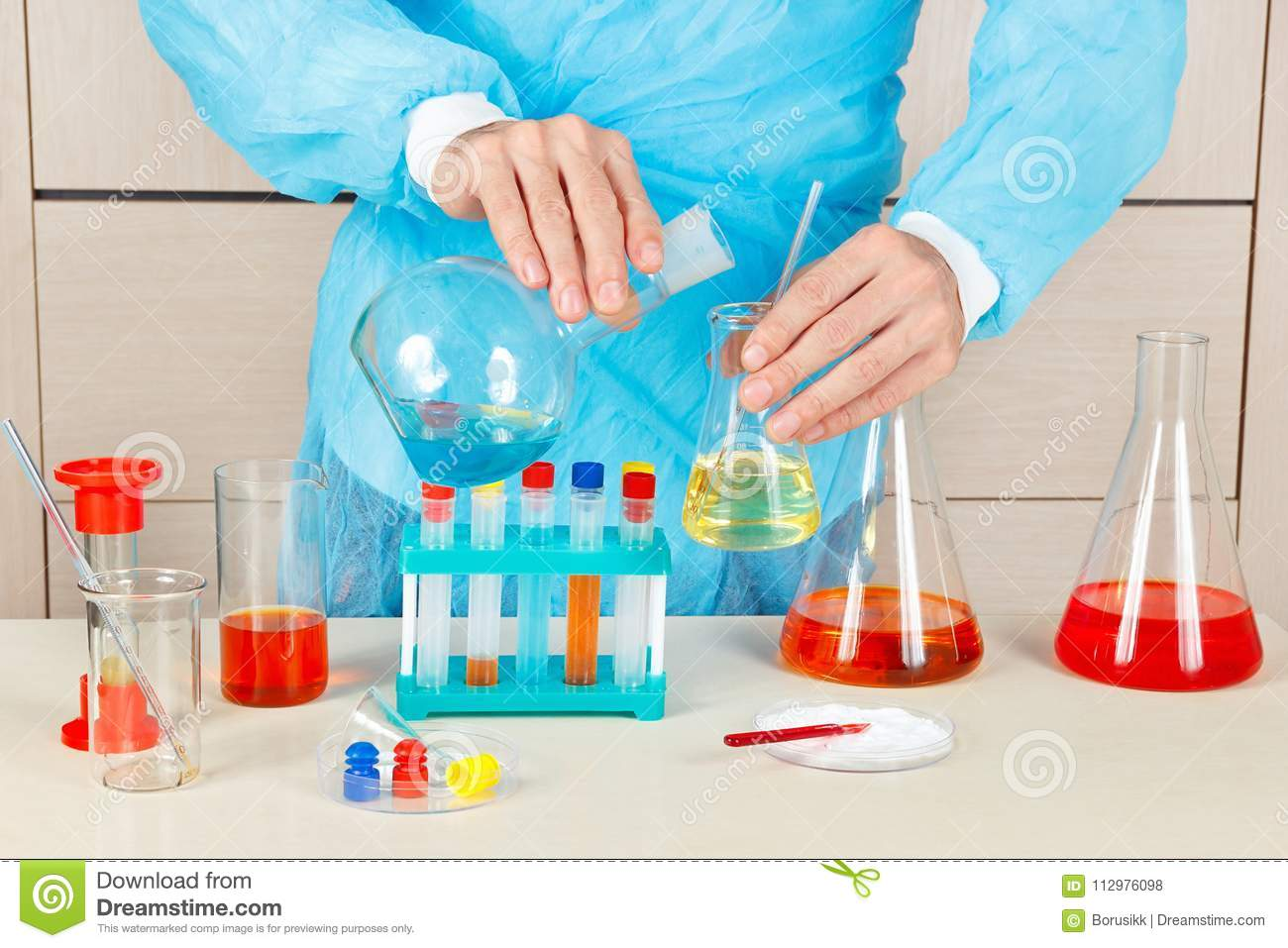 Laboratory Assistant Is Conducting Chemical Experiments In