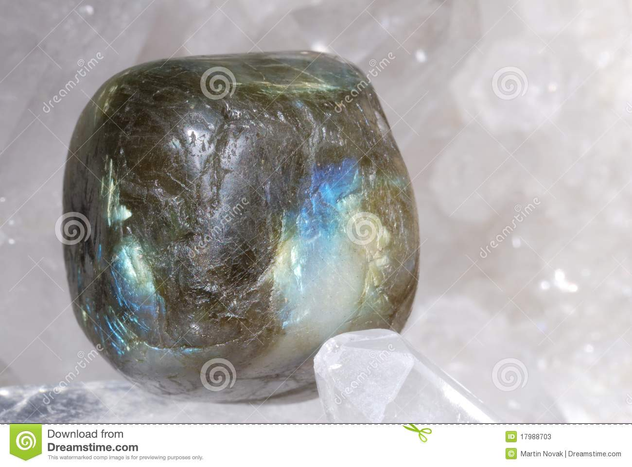 Labradorite laid on druze of quartz