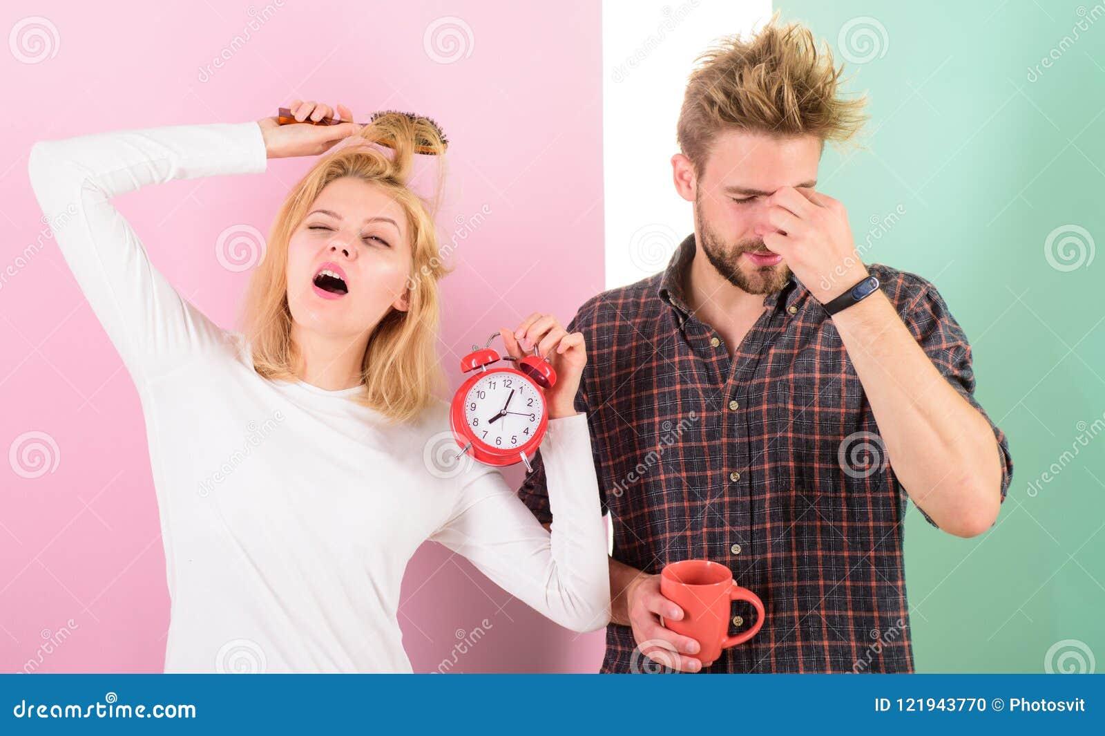 Lack of sleep. Couple sleep not enough time. Family drink morning coffee yawning faces. Couple oversleep awakening hold