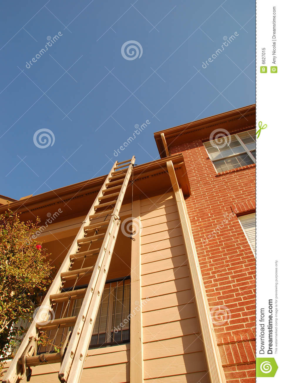 Ladder Leaning On Tall Building Royalty Free Stock Photo