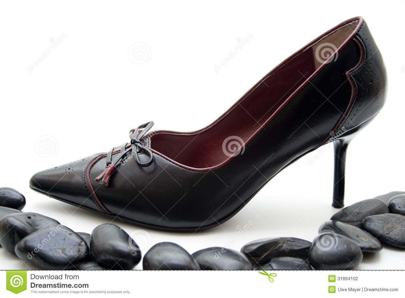 Ladies shoe with black stones and on white background