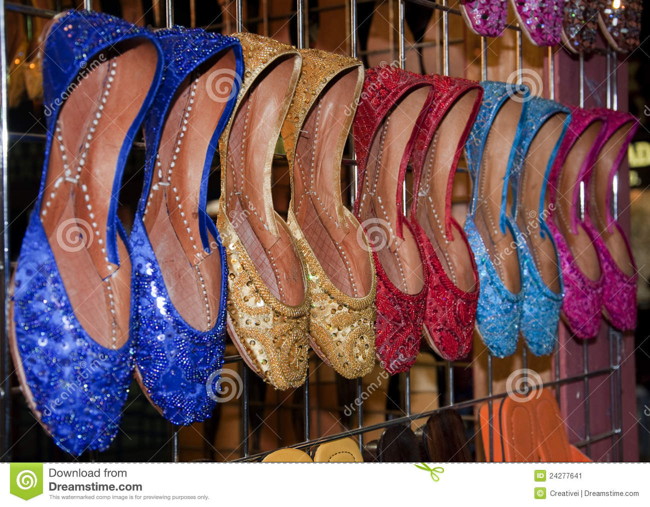 be946a8db213 A collection of colorful Indian and Pakistani style ladies sandal displayed  in a market place.