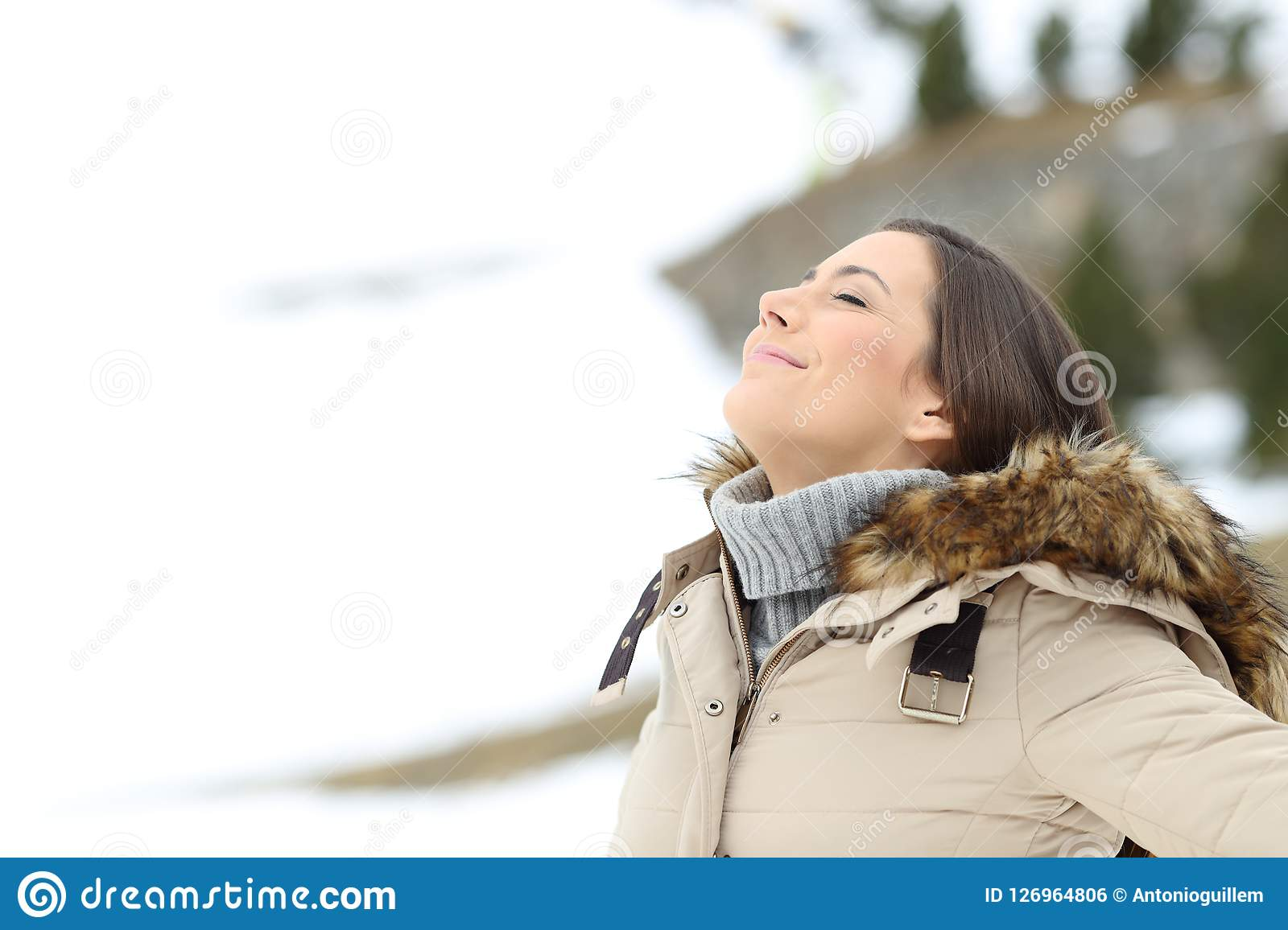 Lady Breathing Fresh Air On Winter Holiday Stock Photo