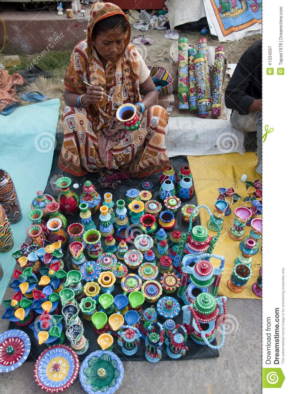 The lady with colourful clay pots editorial photography for Design patterns for pot painting