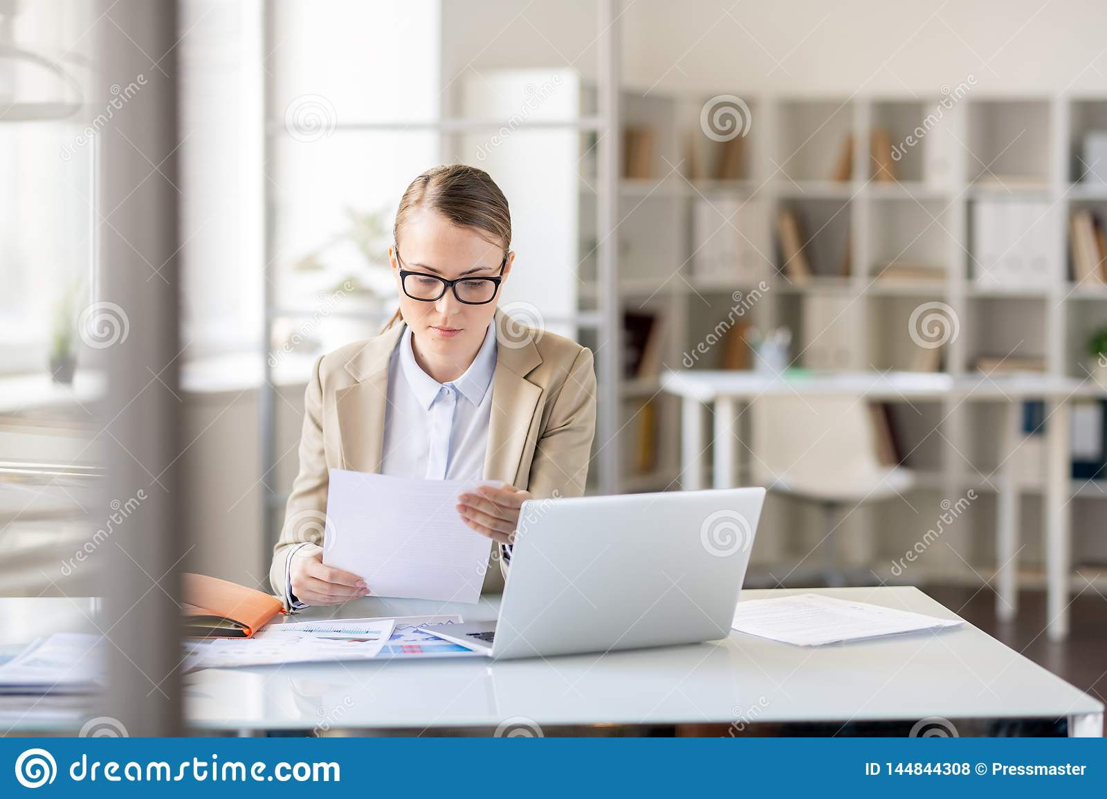 Lady concentrated on report