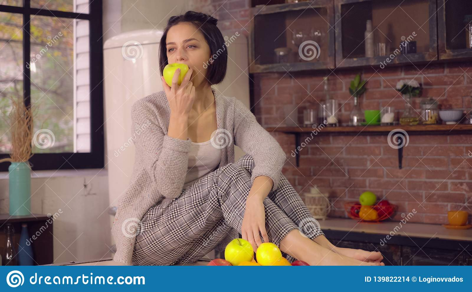 Lady enjoy healthy food at home kitchen.