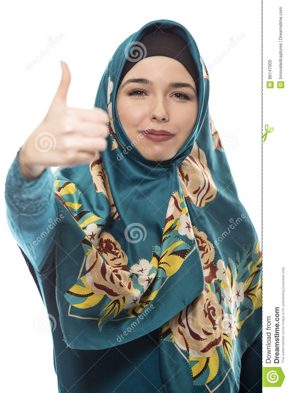 Female wearing a hijab, conservative fashion for muslims, middle east and  eastern european culture. She is isolated on a white background with thumbs  up for ...