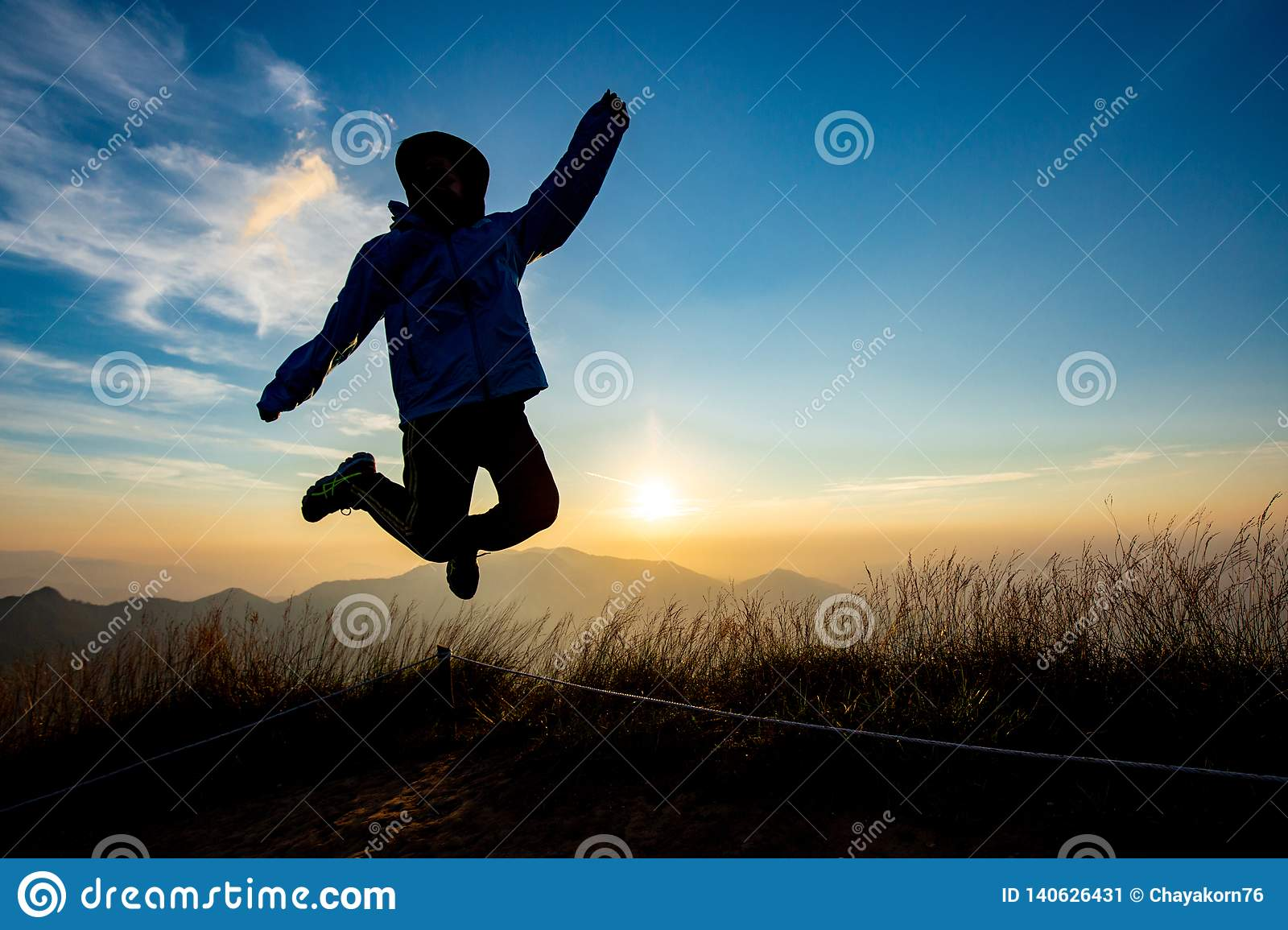 Lady in Jump action with sunset background